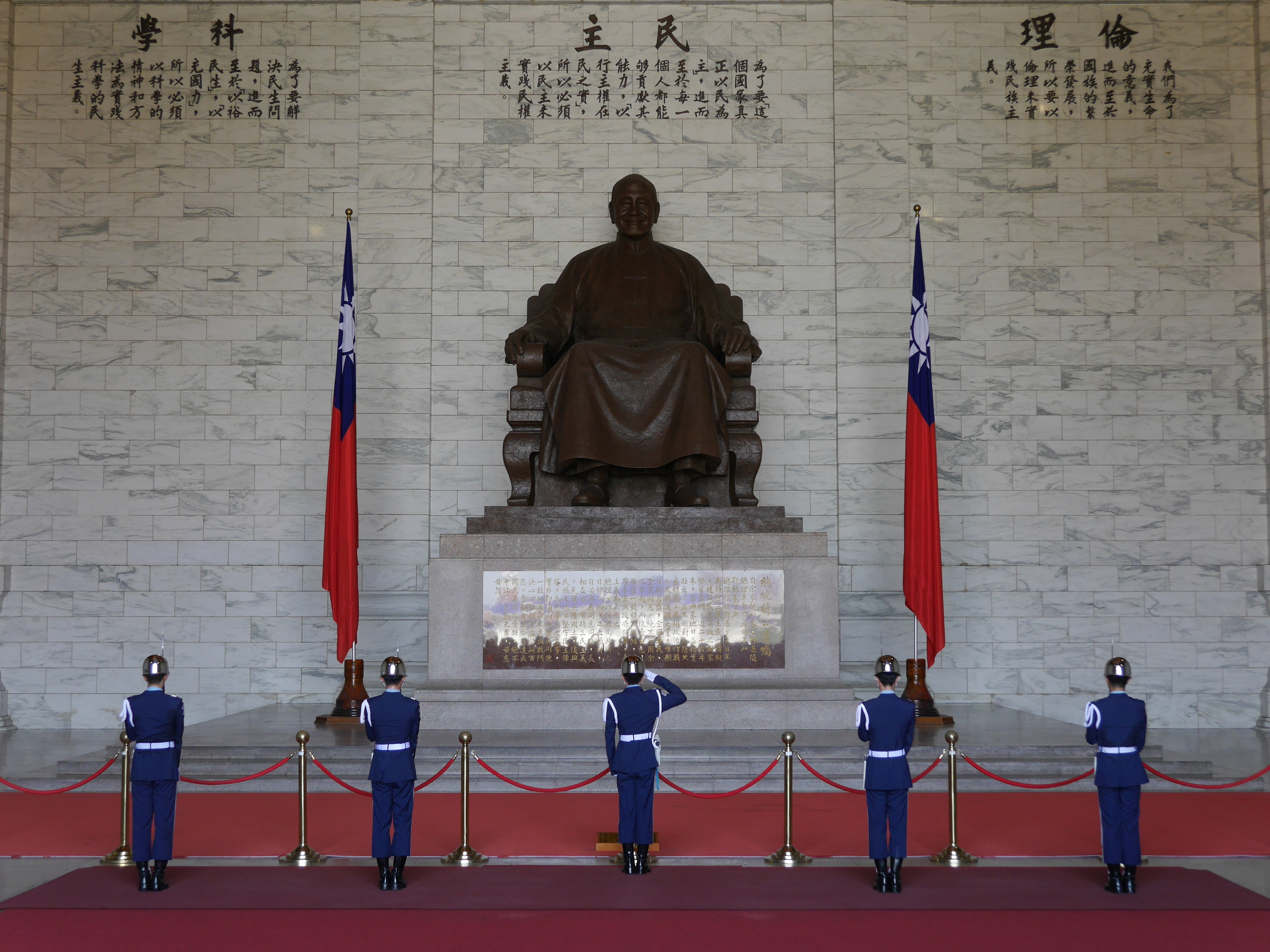 Guards performing the changing of the guard ceremony in front of the statue of Chiang Kai-shek.