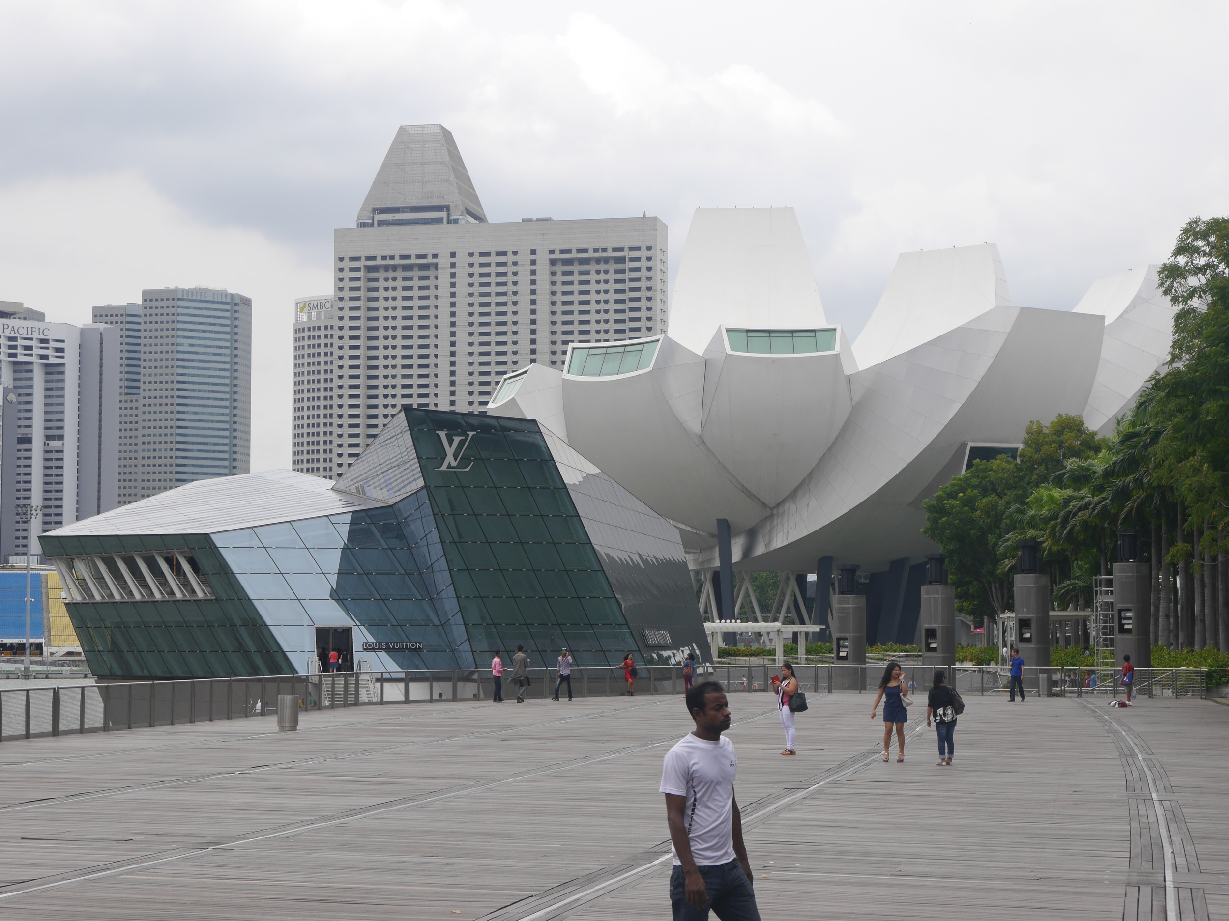 The Singapore ArtScience museum on the right, and a Louis Vuitton store (building?) on the left.