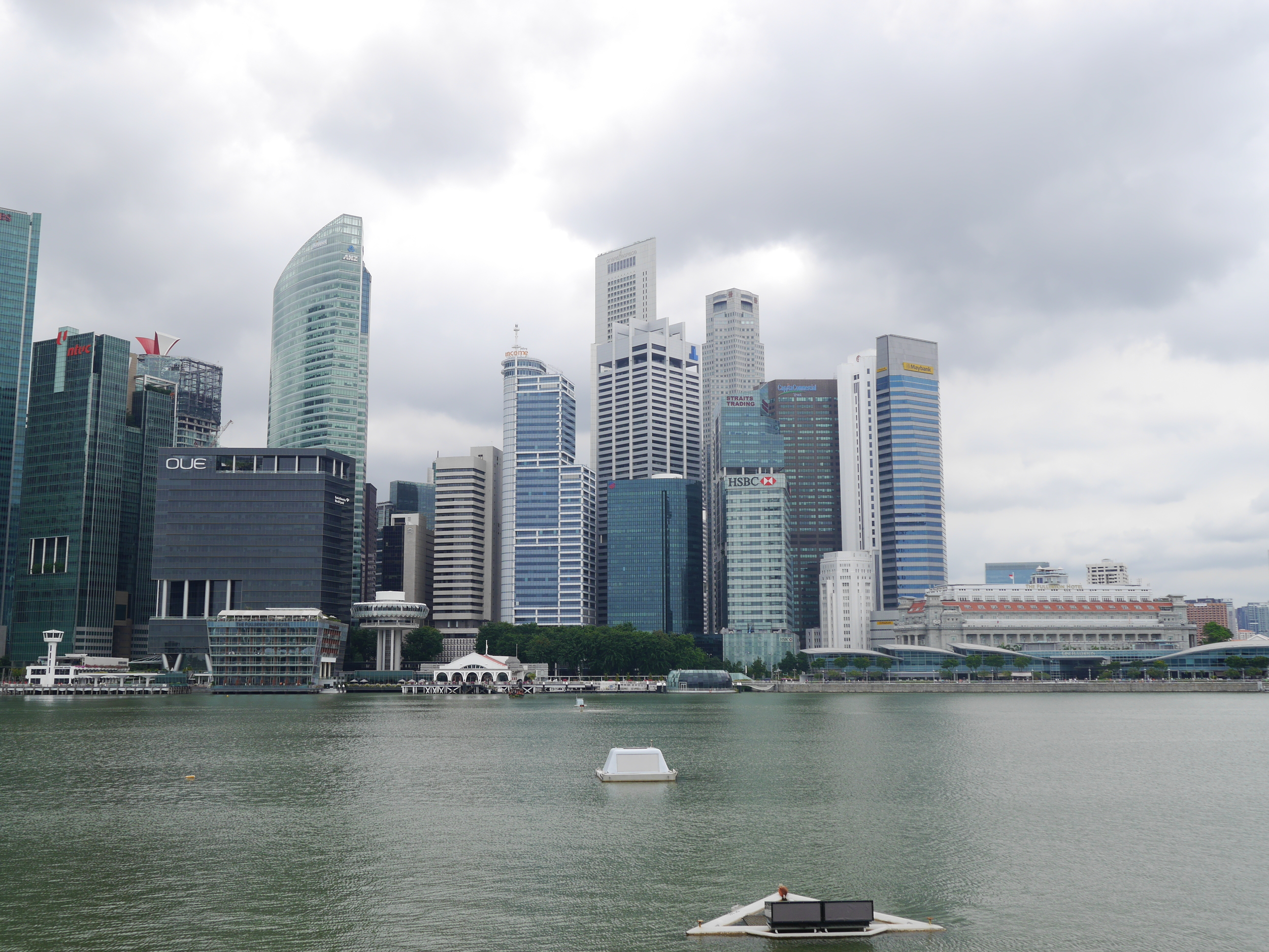 More of the Singapore skyline, including the Fullerton Hotel on the right by the water. Also some strange, air control tower-looking buildings on the left.