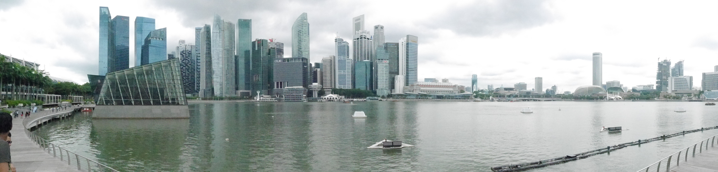The Singapore skyline from the Marina Bay Sands shopping center. Also apparently a boat cutting through my panorama.