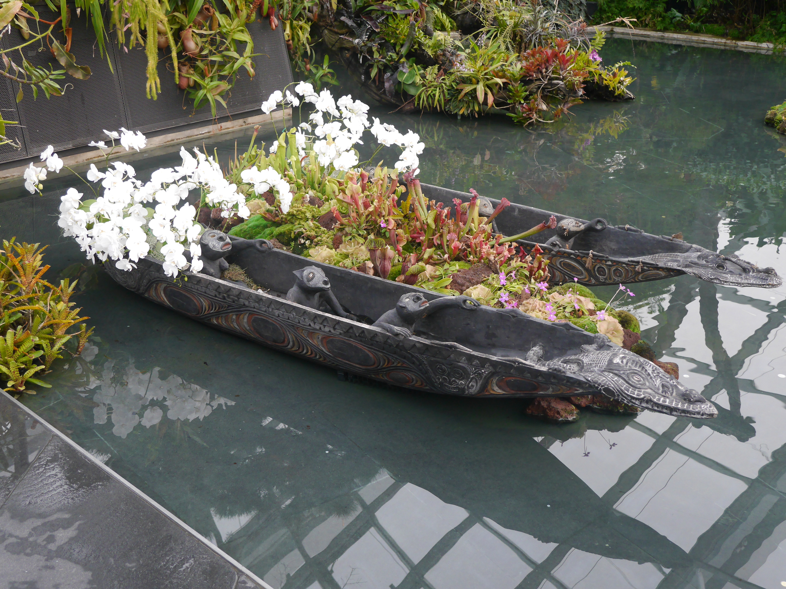 Canoes with some fierce passengers (and orchids).