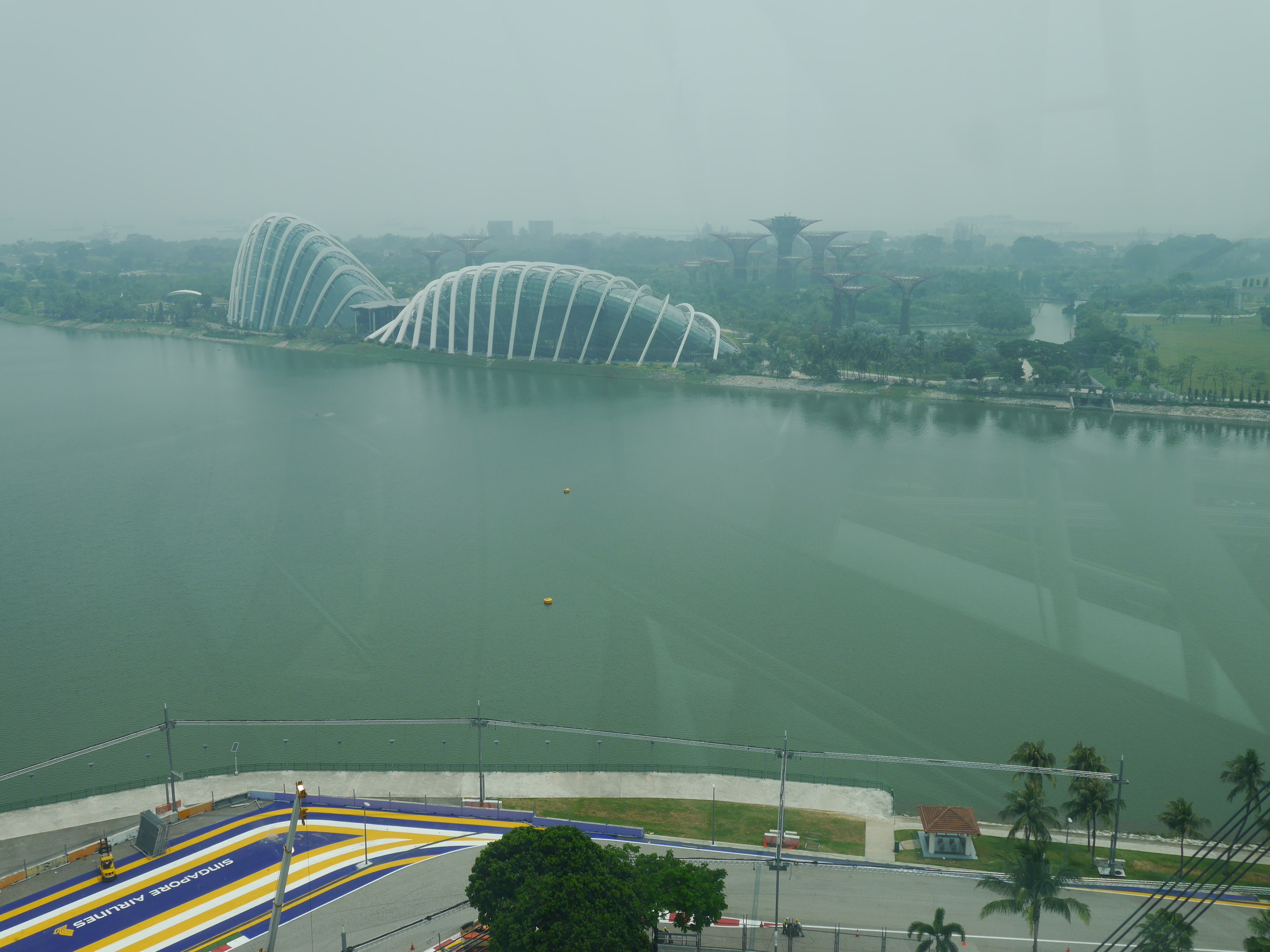 A corner on the Singapore F1 track, with the Gardens by the Bay in the background.