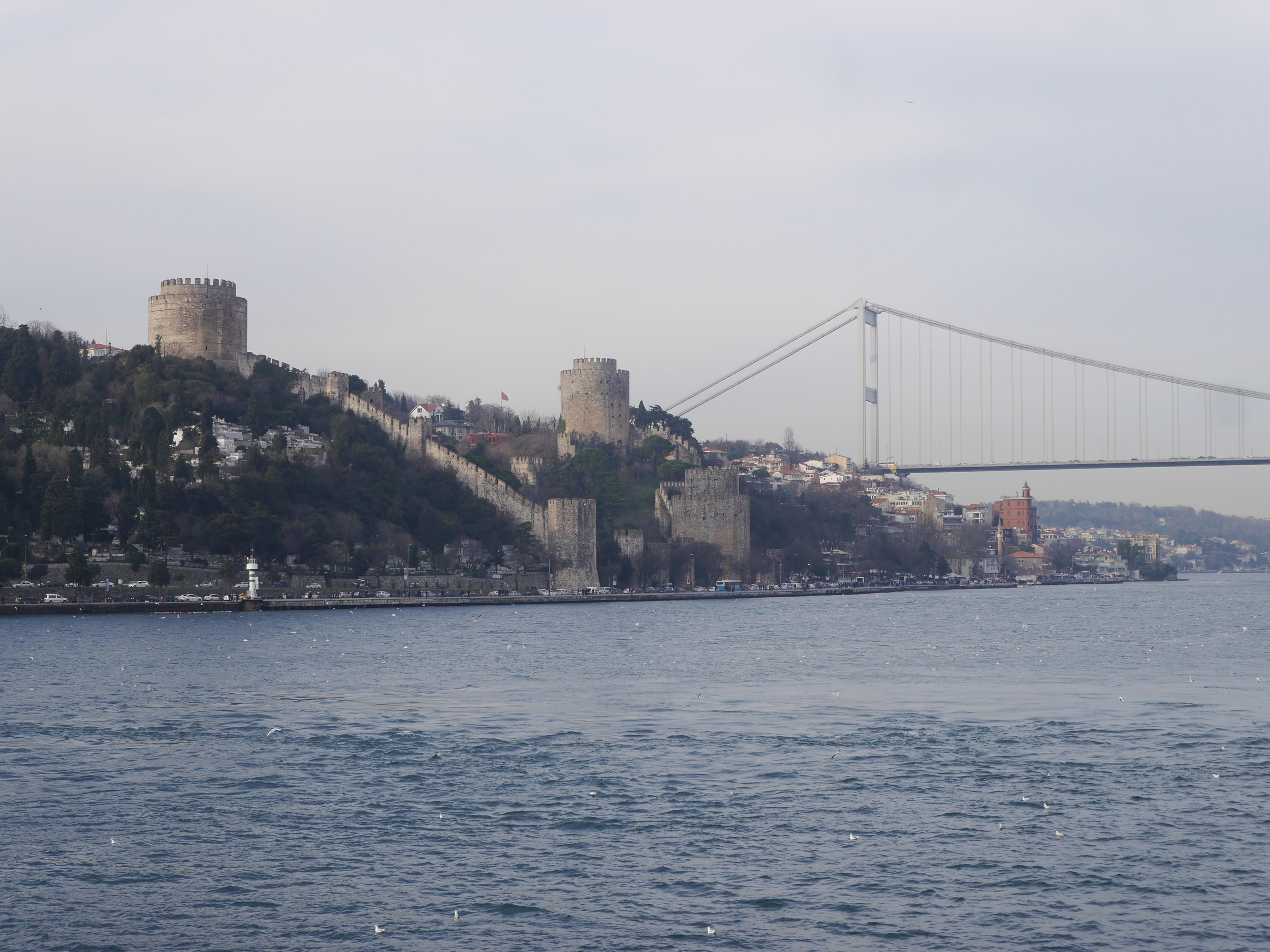 The  Rumelishisari , a fortress constructed between 1451 and 1452, flanked by the  Faith Sultan Mehmet Bridge , completed in 1988 (the second of the only two bridges spanning the strait).