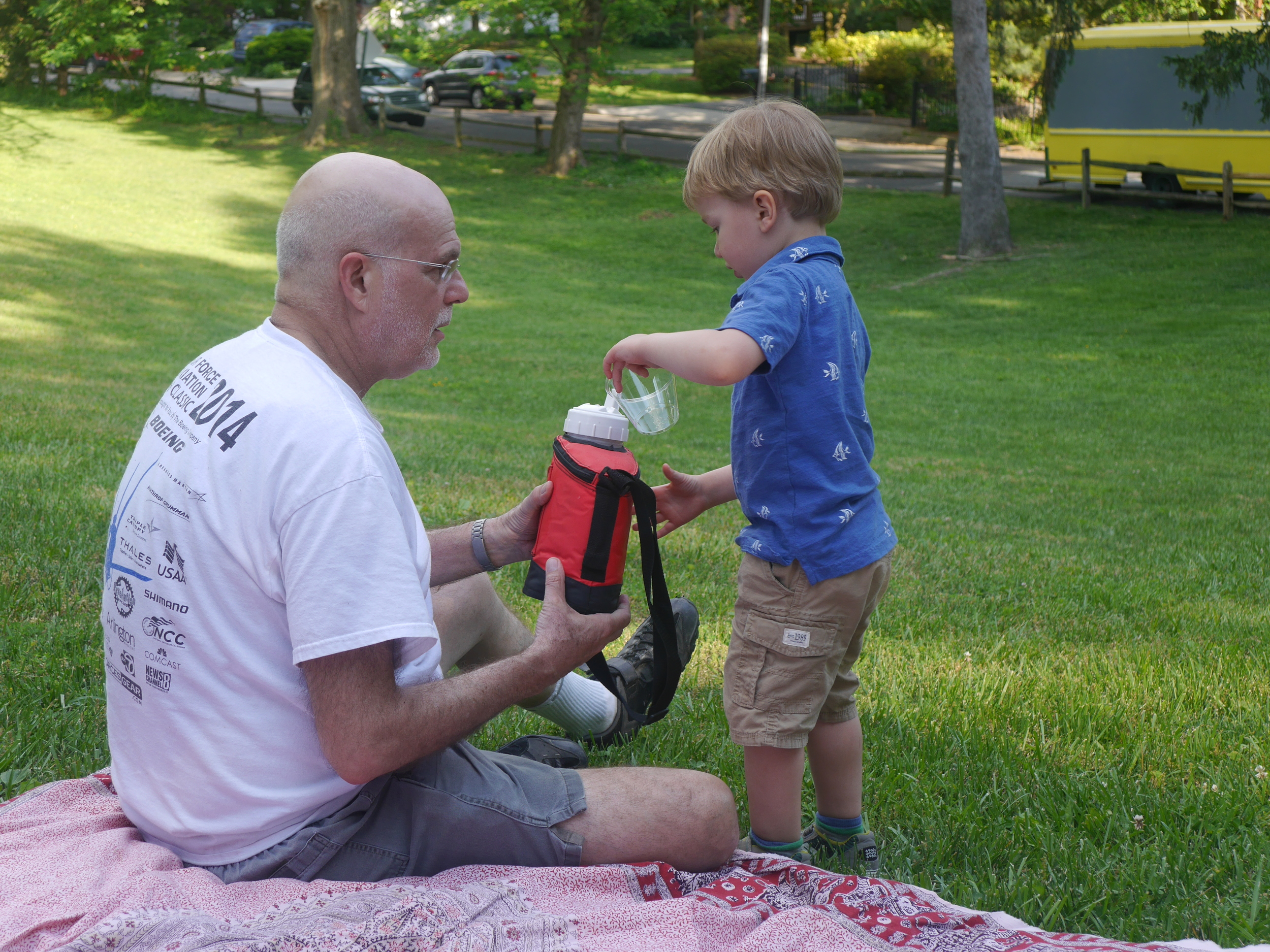 Dad helping Sebastian with the water (or maybe the other way around).