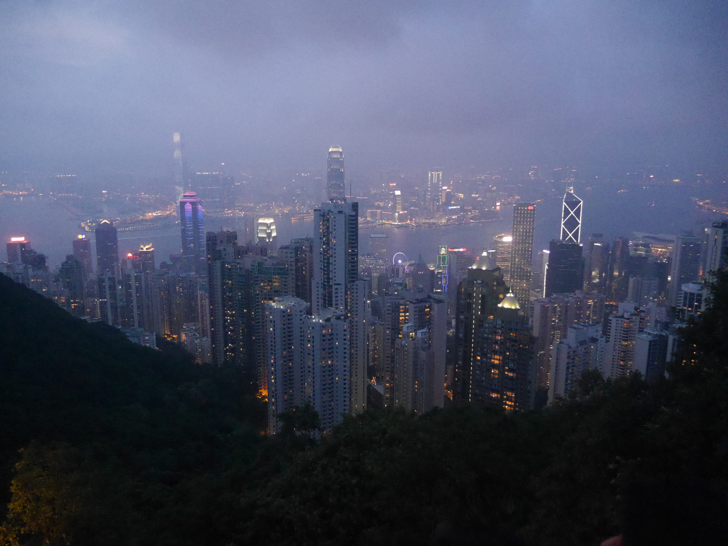 The Hong Kong skyline at night. Hong Kong Island in the foreground, Kowloon in the background.