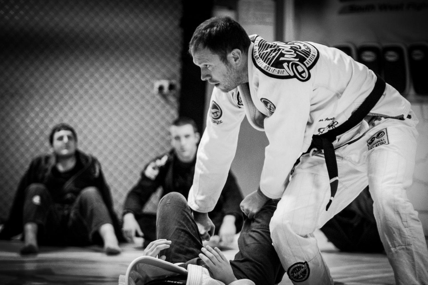 Black Belt instructor Paul Carthy demonstrating a Guard Pass technique to the class