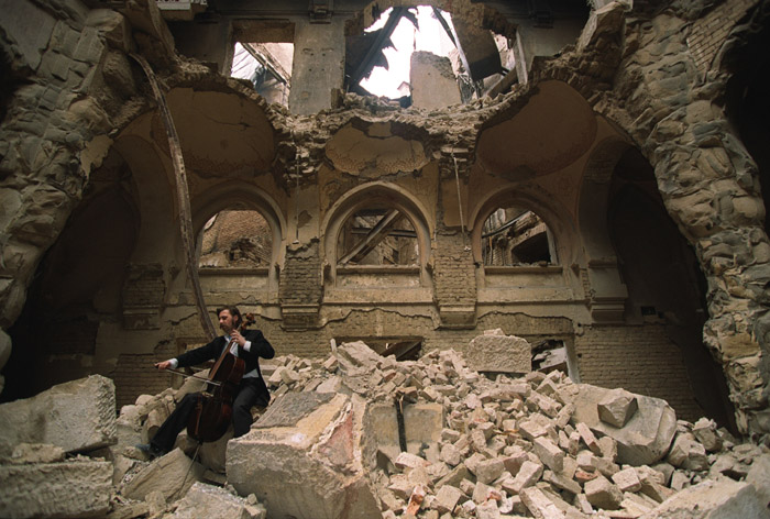 Vedran Smailović plays Cello in the destroyed National and University Library of Bosnia and Herzegovina. Photograph by Mikhail Evstafiev, from  http://commons.wikimedia.org/wiki/File:Evstafiev-bosnia-cello.jpg#mediaviewer/File:Evstafiev-bosnia-cello.jpg