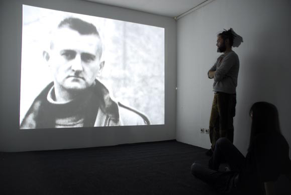 "Adela Jušić, 2007,  The Sniper , Exhibition view ""SPA PORT"", International Biennial of Contemporary Art, Banja Luka, Bosnia and Herzegovina. From  https://adelajusic.wordpress.com/works/the-sniper/"