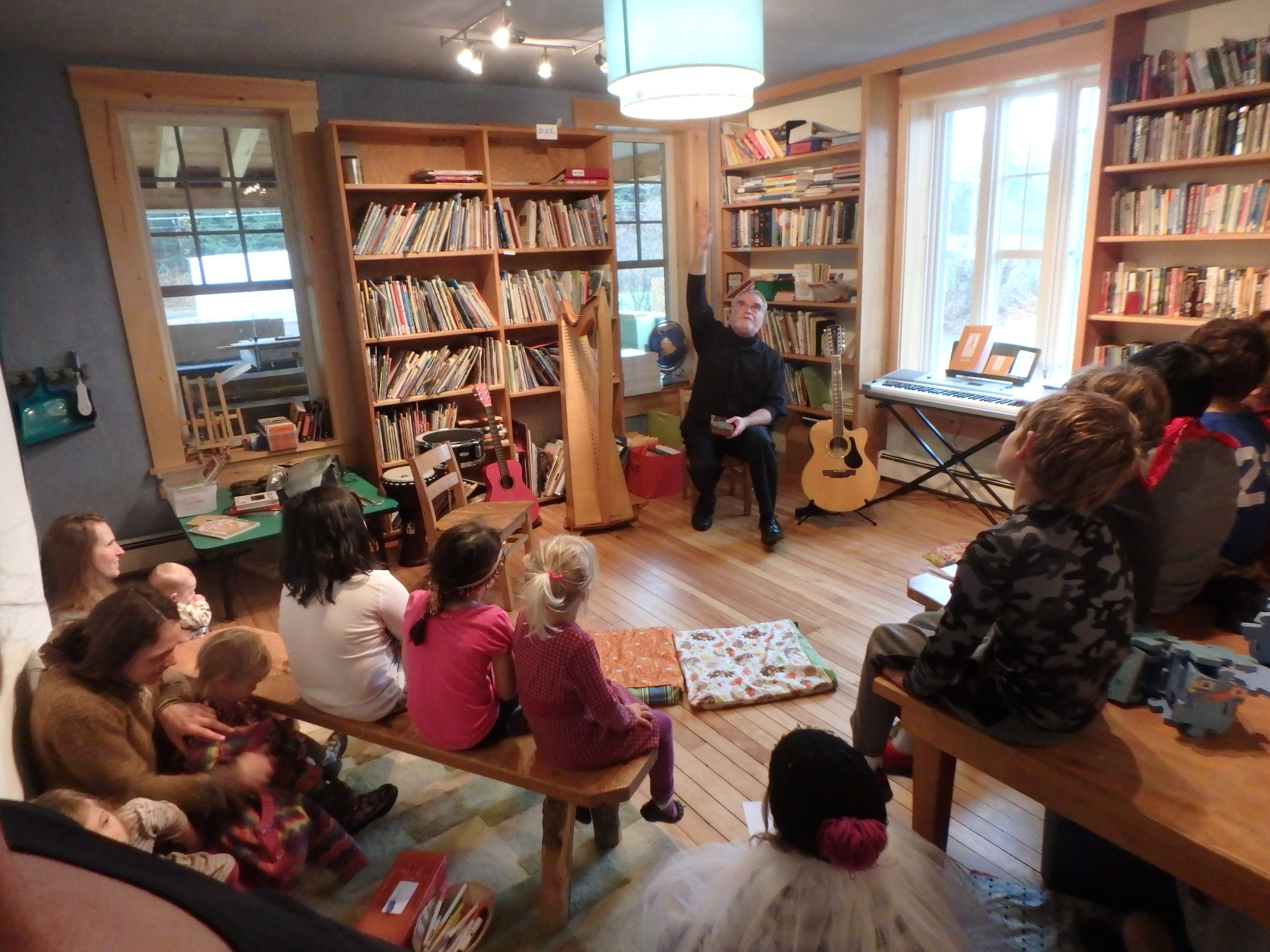 ...we have a special visitor? - Students and families alike were rapt with attention when storyteller and musician Odds Bodkin came to Woodland! With his celtic harp, and 12-string guitar, he enchanted young and old alike with his stories of empathy and kindness. Needless to say, one hour was not nearly long enough!