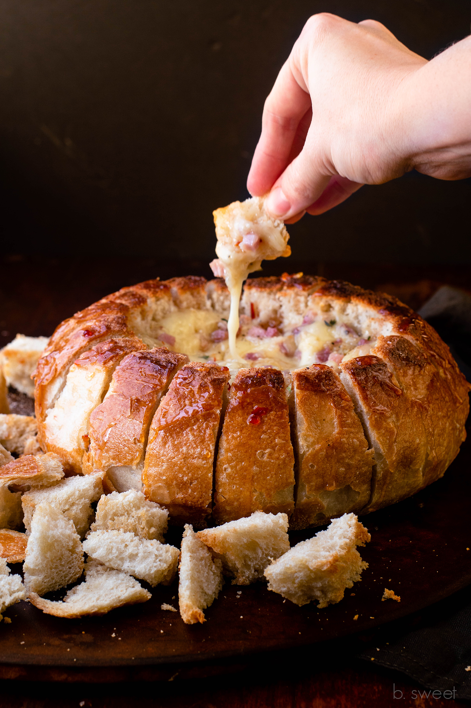 Garlic Prosciutto and Hot Honey Baked Brie Bread Bowl  - b. sweet