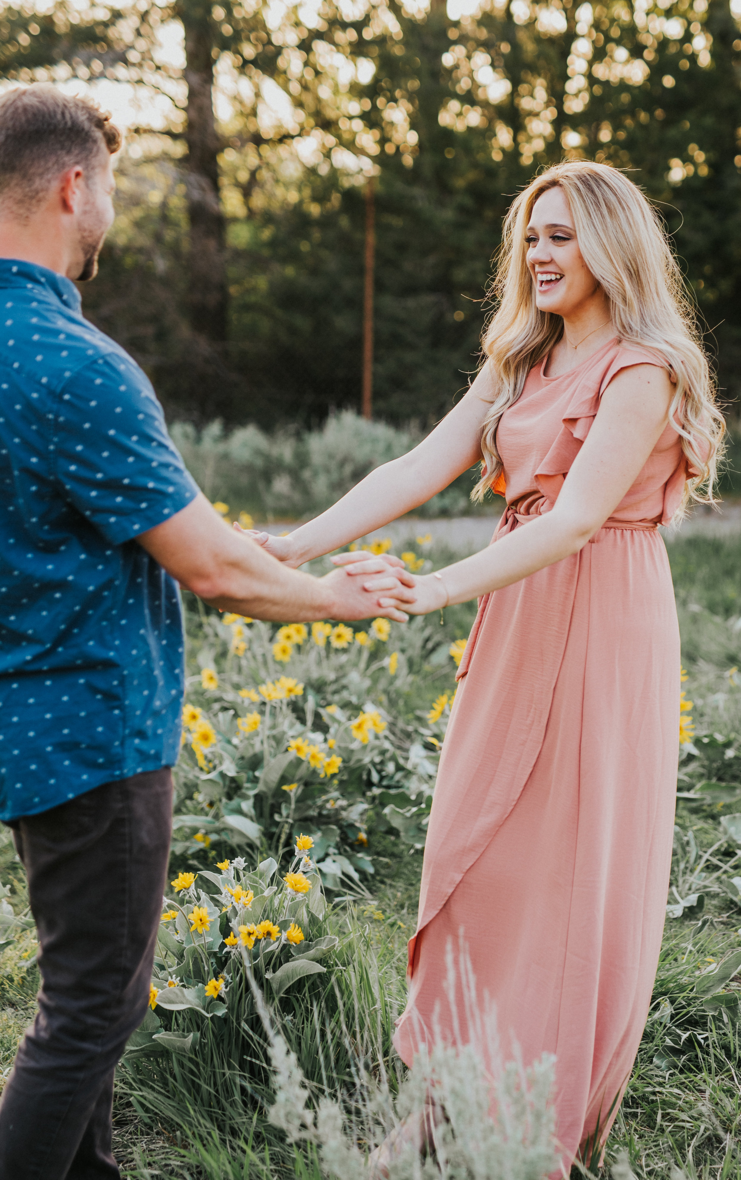 the focus collective workshop photographer workshop mentor session couple session couple formal session semi casual outfit ideas blue and pink outfit ideas couple posing in a field couple posing by wildflowers couple holding hands couple posing ideas engagement photos summer engagement photos #utahweddingphotographer #cachevalleyweddingphotographer #happycouple #couplegoals #relationshipgoals #bridetobe #mrandmrs #engagements #engagementsession #engagementring