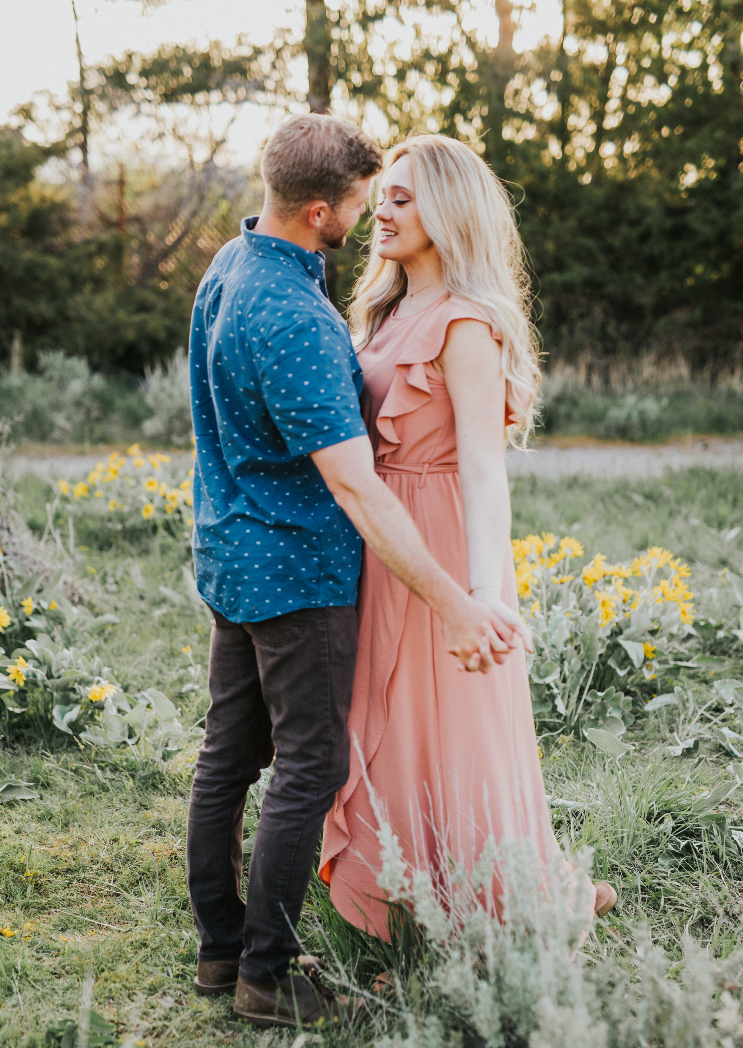 the focus collective workshop photographer workshop mentor session blue and pink outfit inspo semi casual outfit engagement session posing ideas for couples couple standing in a field location ideas for engagement photos engagement photo ideas couple holding hands engagement outfit inspo what to wear to engagement sessions #loganutah #utahweddingphotogapher #engagements #cachevalleyweddingphotographer #couplegoals #engagementsession #engagementphotos #relationshipgoals #bridetobe #mrandmrs