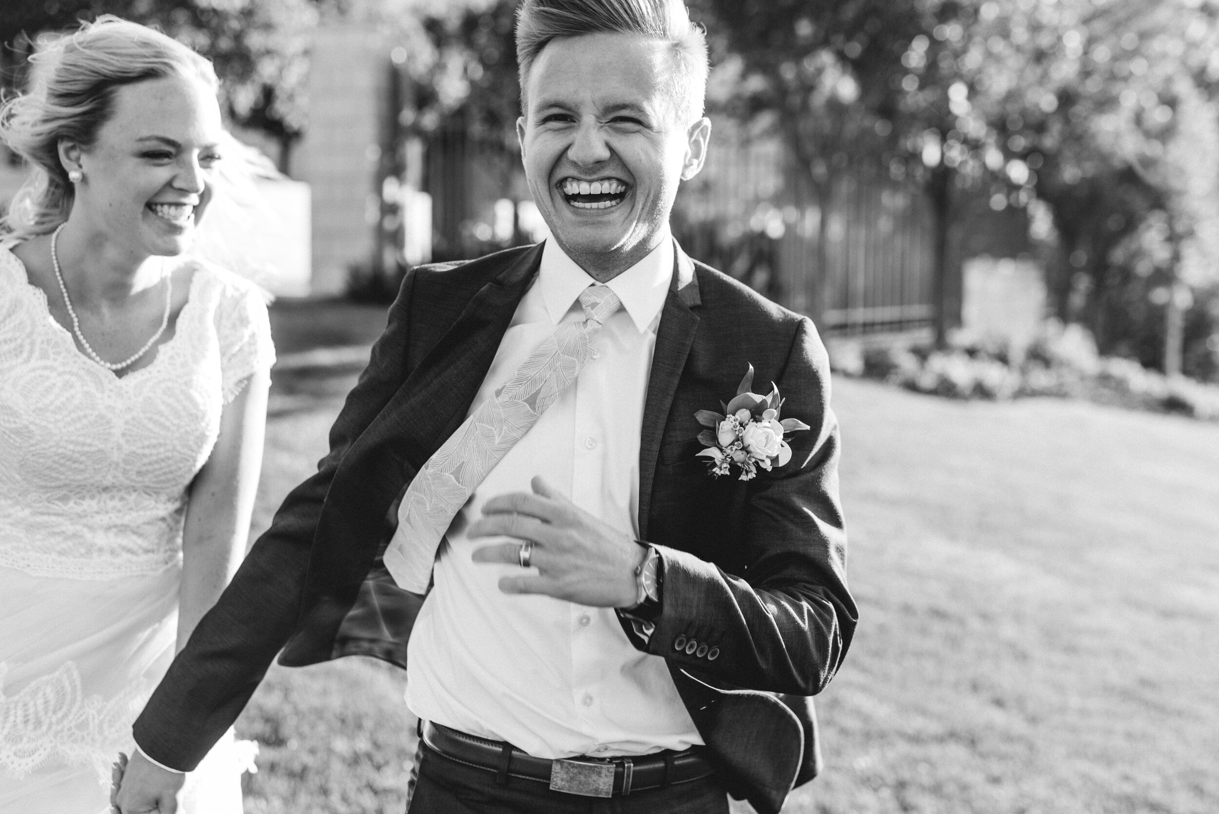 wedding_couple_running_and_laughing.JPG
