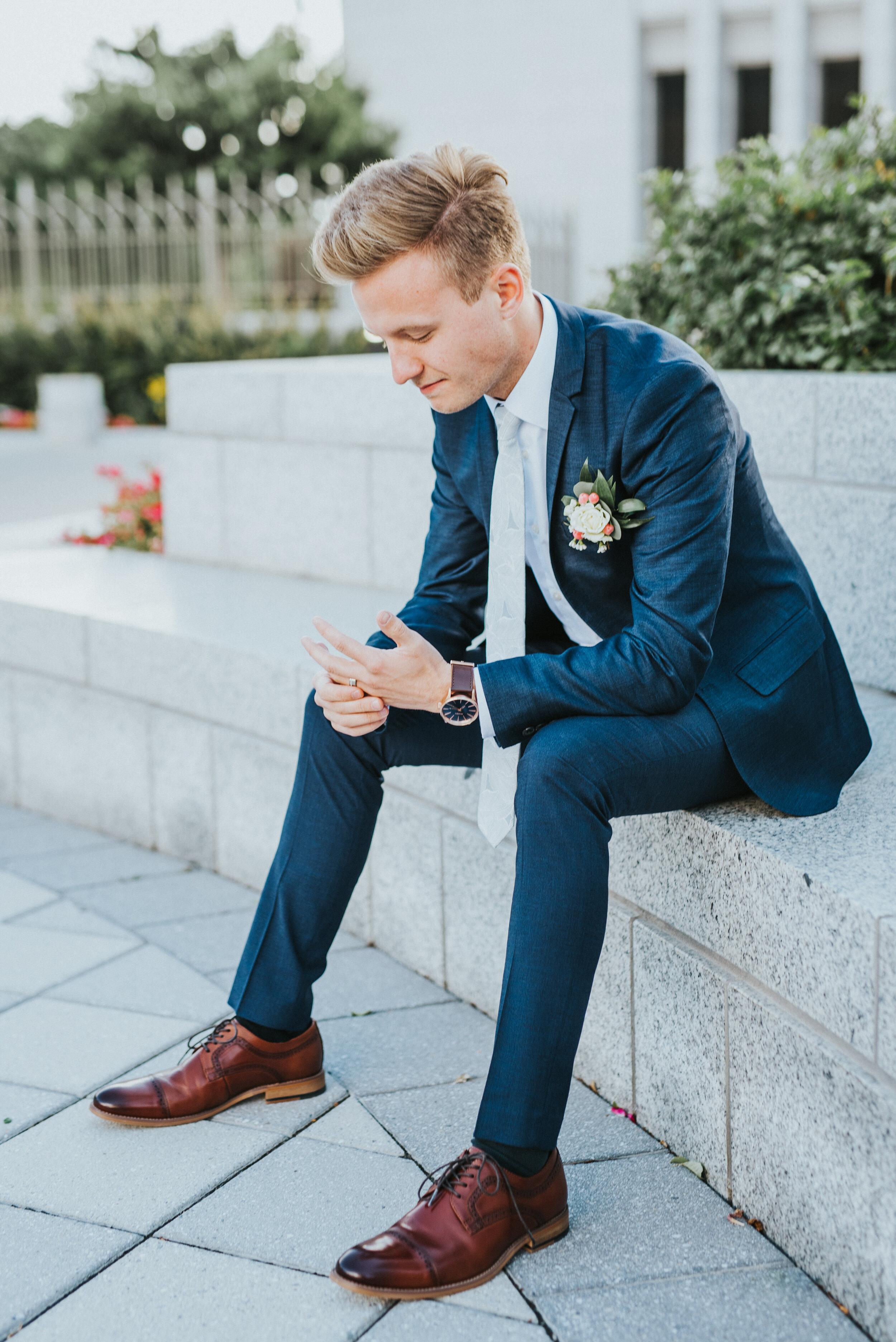 groom_sitting_on_bench.JPG