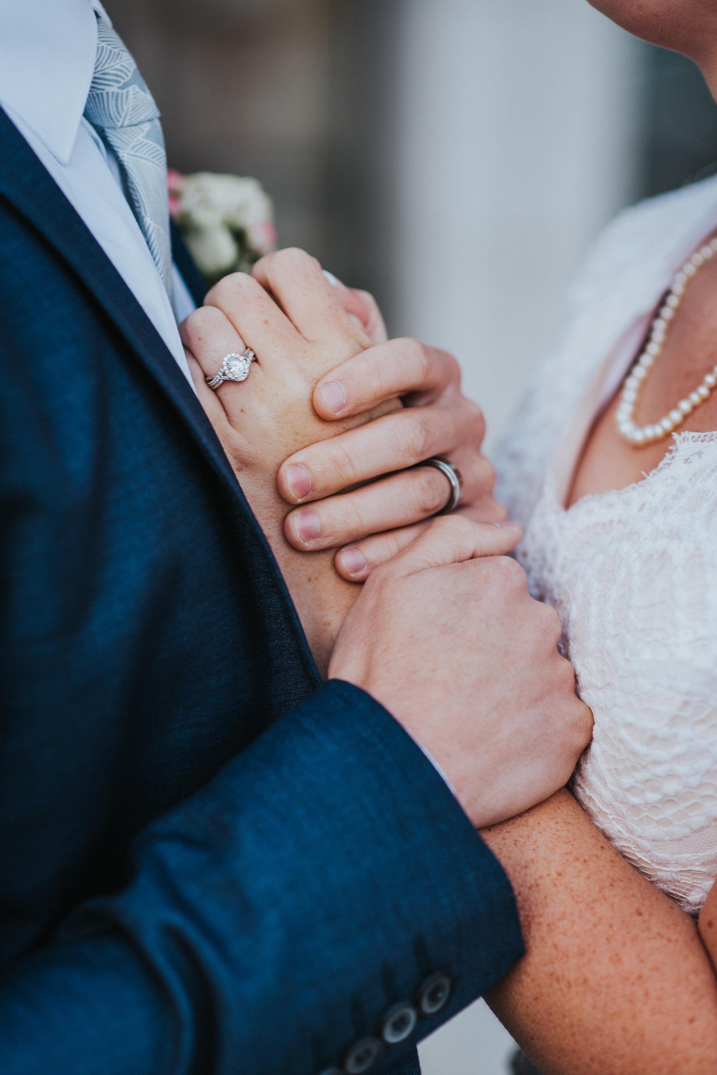 holding_hands_wedding_rings.jpeg