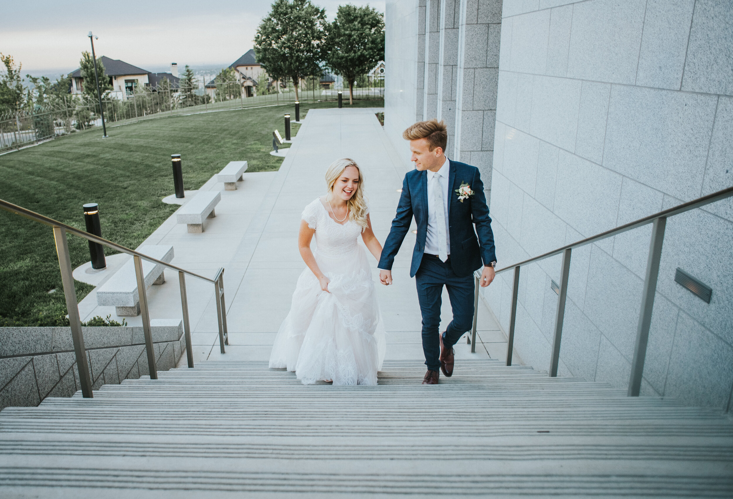 wedding_couple_walking_up_strairs.JPG