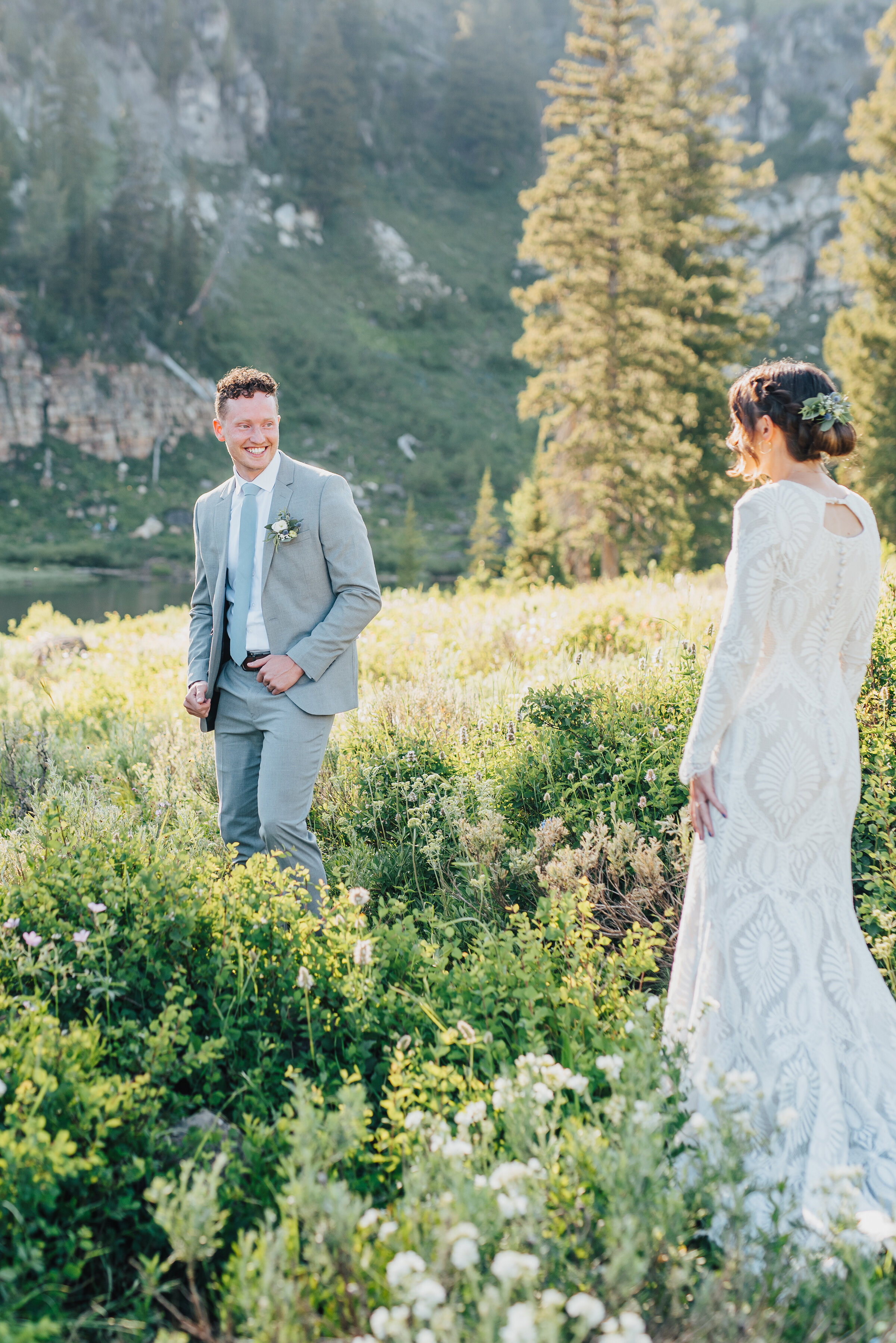 Overjoyed groom at the sight of his bride to be during their first look up Logan canyon at Tony Grove. Kristi Alyse photography Logan Utah wedding photographer forest nature dreamy formals Logan canyon Tony Grove scenic bridals Northern Utah photographer Utah brides bride and groom Cache Valley #kristialysephotography #loganutahphotographer #tonygrove #logancanyon #utahweddingphotographer #bridals #formals #wildflowers #northernutah #utahbrides