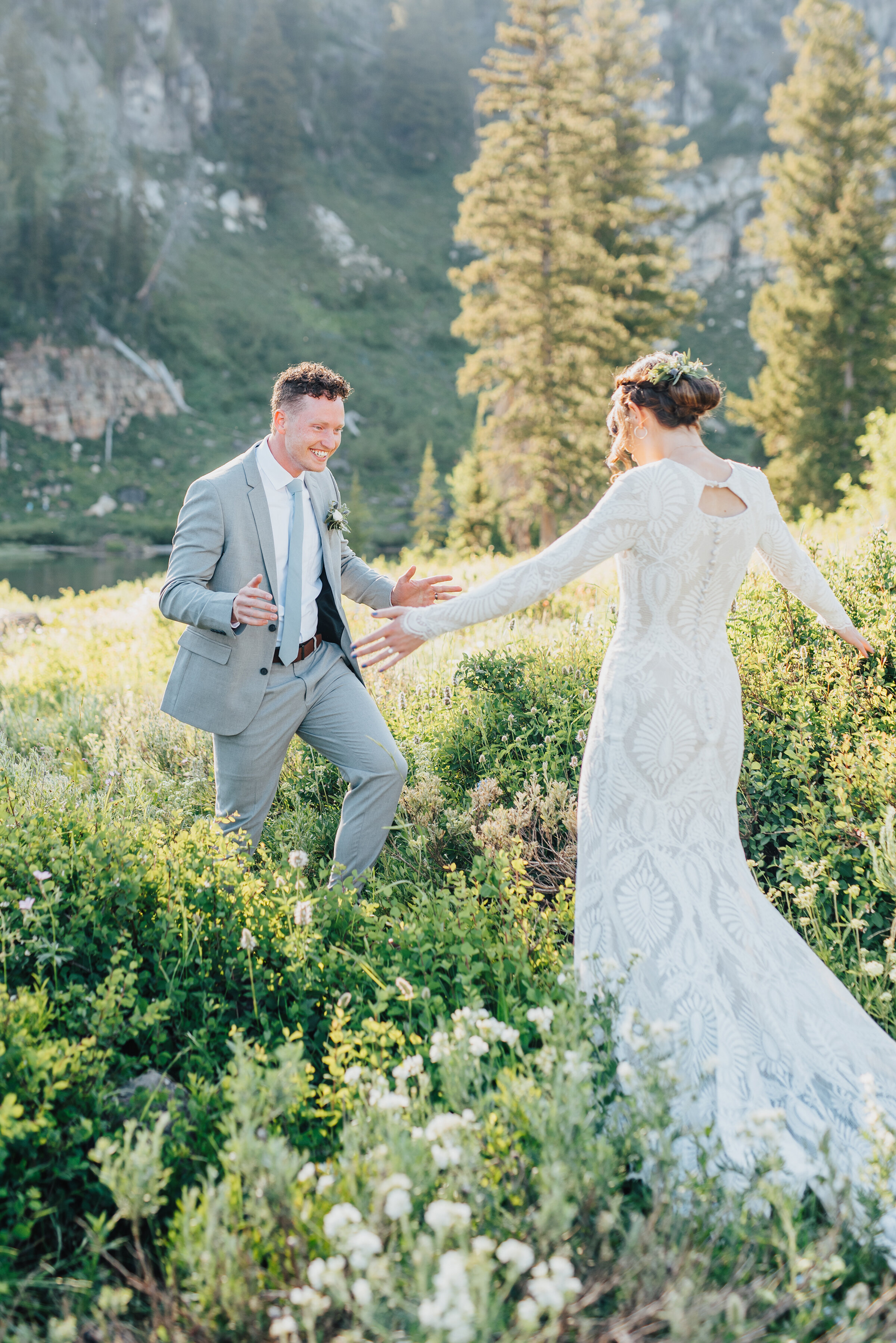 Joyful bride and groom in a dreamy meadow up Logan canyon for their first look. Kristi Alyse photography Logan Utah wedding photographer forest nature dreamy formals Logan canyon Tony Grove scenic bridals Northern Utah photographer Utah brides bride and groom Cache Valley #kristialysephotography #loganutahphotographer #tonygrove #logancanyon #utahweddingphotographer #bridals #formals #wildflowers #northernutah #utahbrides