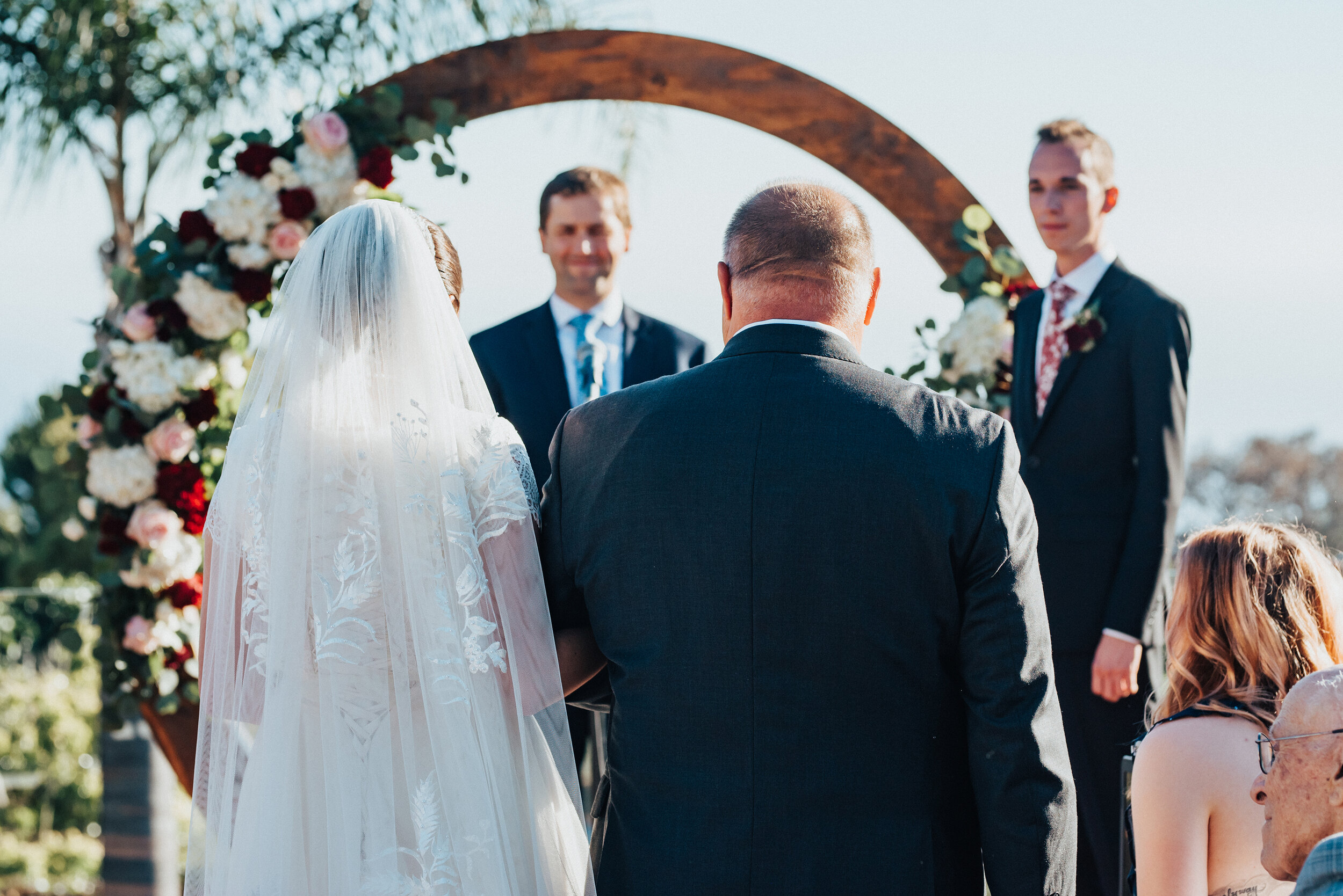 Father of the bride walking his daughter to her groom at this lovely backyard wedding in Laguna Beach. Kristi Alyse photography Laguna Beach wedding California brides Logan Utah wedding photographer backyard wedding destination photographer covid wedding bride and groom #kristialysephotography #weddingphotography #Lagunabeach #destinationphotographer #weddingday #love #backyardwedding #loganutahphotographer #californiawedding #californiabrides