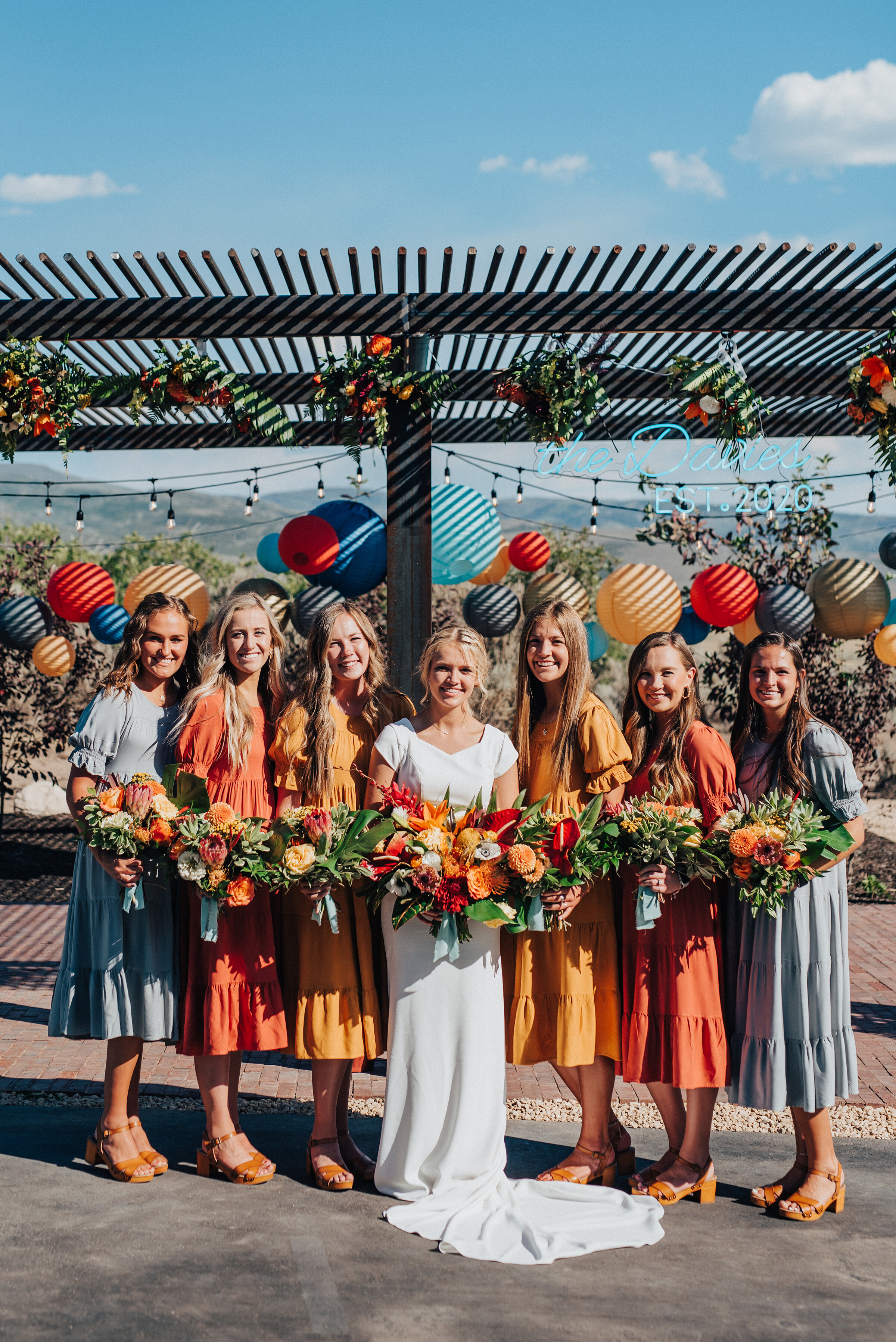 Stunning bridesmaids and bride holding beautifully handcrafted bouquets for this socially distant wedding in Park City. Kristi Alyse Photography Logan Utah photographer Park City wedding photographer Drive-Thru wedding COVID wedding neon signs socially distant wedding bride bridesmaids #kristialysephotography #weddingphotographer #utahweddings #parkcity #utahbrides #drivethruwedding #covidwedding #LoganUtahphotographer #utahweddingphotographer #bridesmaids