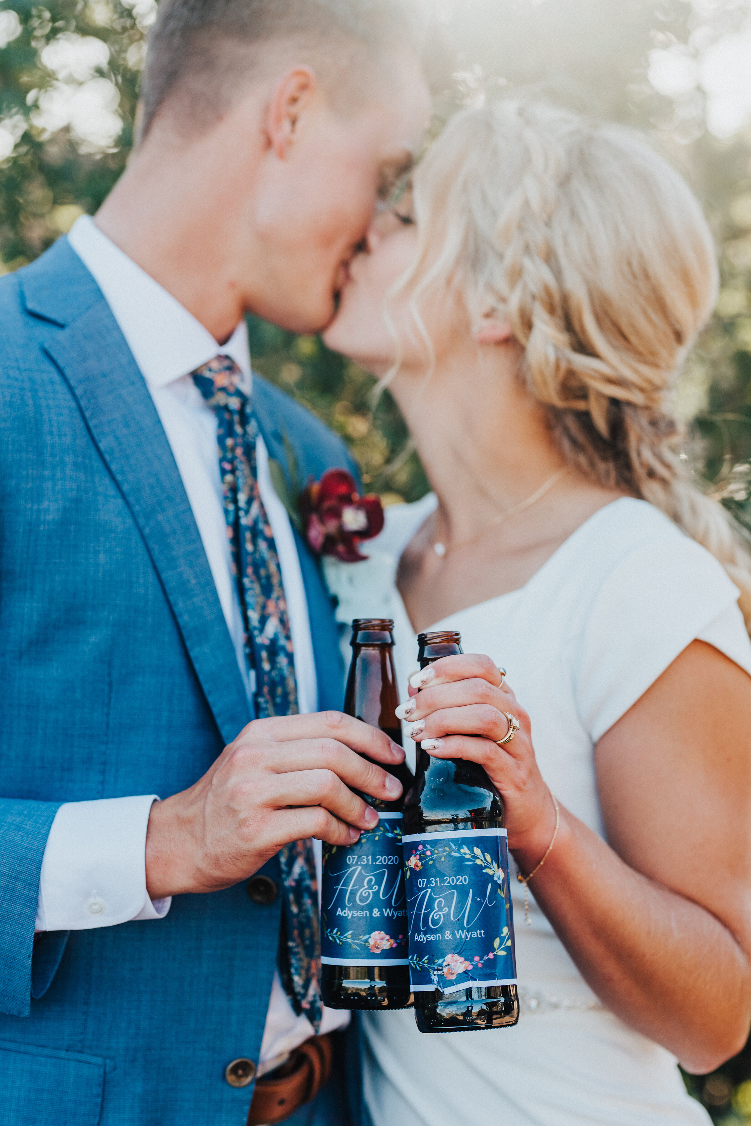 Locking lips with drinks in hand for these two newlyweds at their backyard wedding reception in Park City. Kristi Alyse Photography Logan Utah photographer Park City wedding photographer Drive-Thru wedding COVID wedding neon signs socially distant wedding bride and groom #kristialysephotography #weddingphotographer #utahweddings #parkcity #utahbrides #drivethruwedding #covidwedding #LoganUtahphotographer #utahweddingphotographer