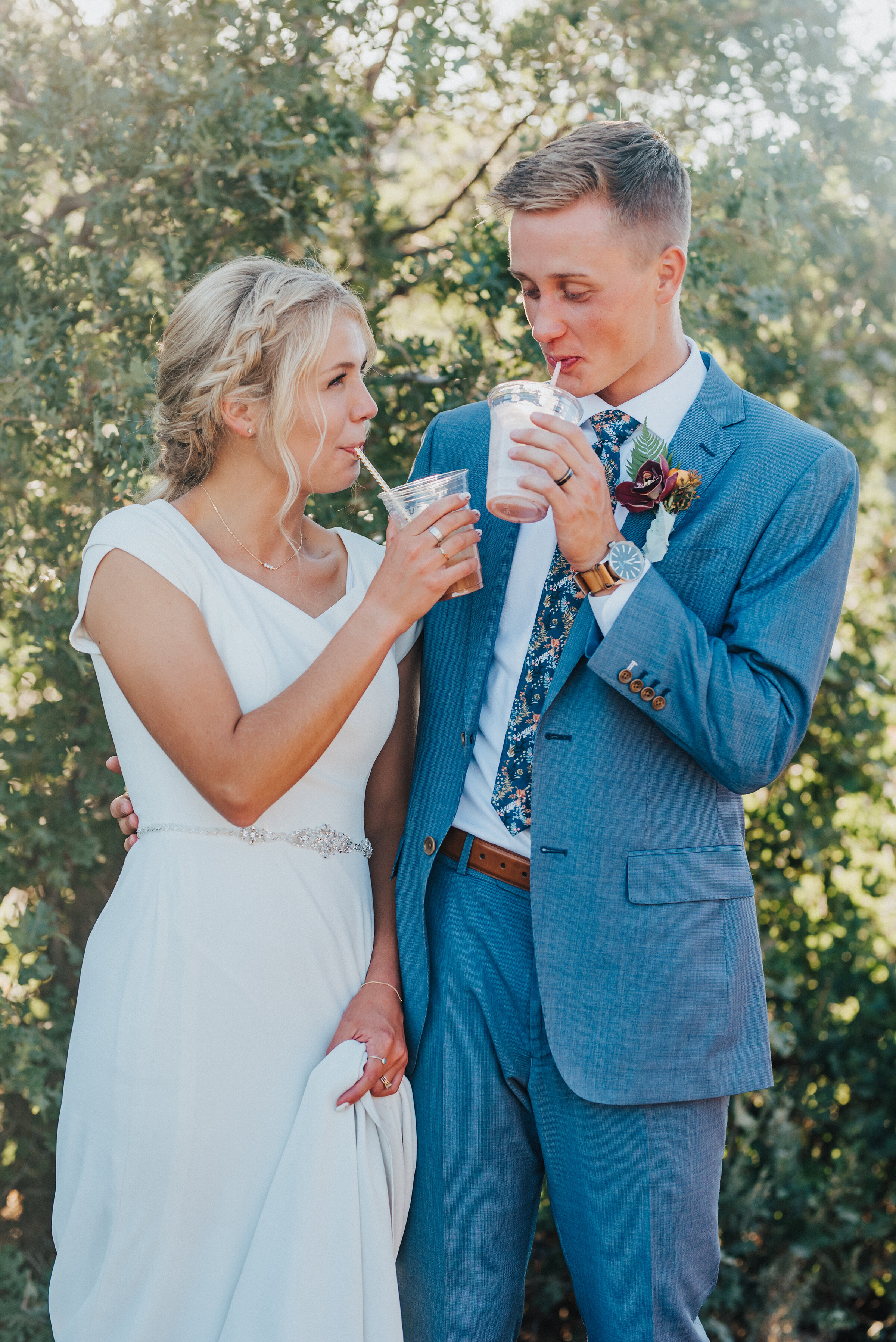 Cute newlyweds sipping drinks at their socially distant wedding reception in Park City. Kristi Alyse Photography Logan Utah photographer Park City wedding photographer Drive-Thru wedding COVID wedding neon signs socially distant wedding bride and groom #kristialysephotography #weddingphotographer #utahweddings #parkcity #utahbrides #drivethruwedding #covidwedding #LoganUtahphotographer #utahweddingphotographer