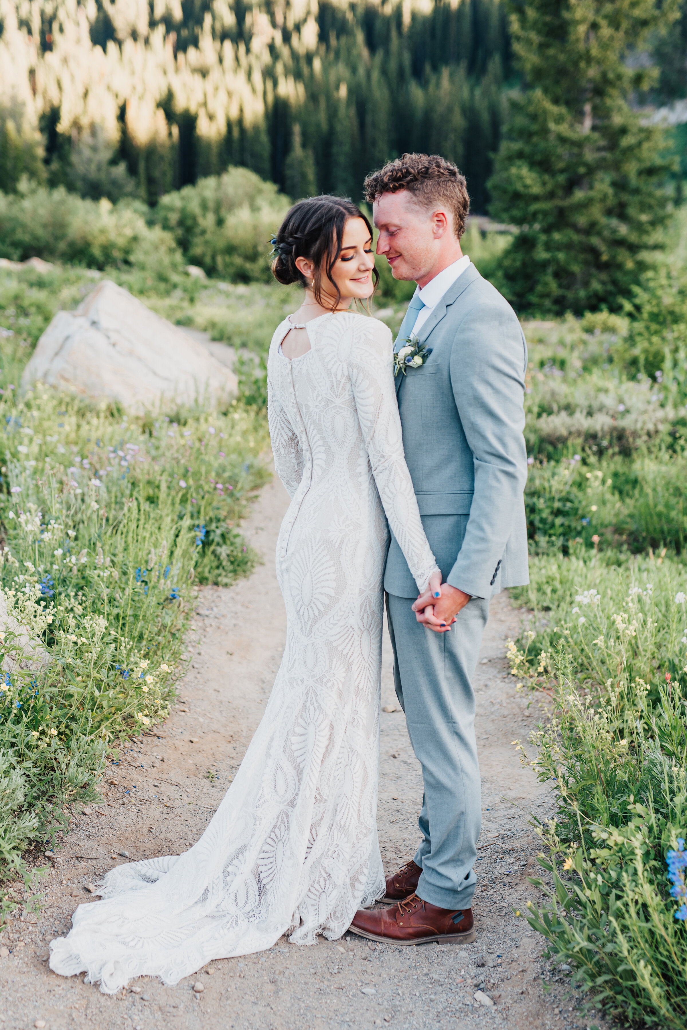 Charming bride and groom in love surrounded by wild flowers up Logan canyon during this bridal session. Kristi Alyse photography Logan Utah wedding photographer forest nature dreamy formals Logan canyon Tony Grove scenic bridals Northern Utah photographer Utah brides bride and groom Cache Valley #kristialysephotography #loganutahphotographer #tonygrove #logancanyon #utahweddingphotographer #bridals #formals #wildflowers #northernutah #utahbrides
