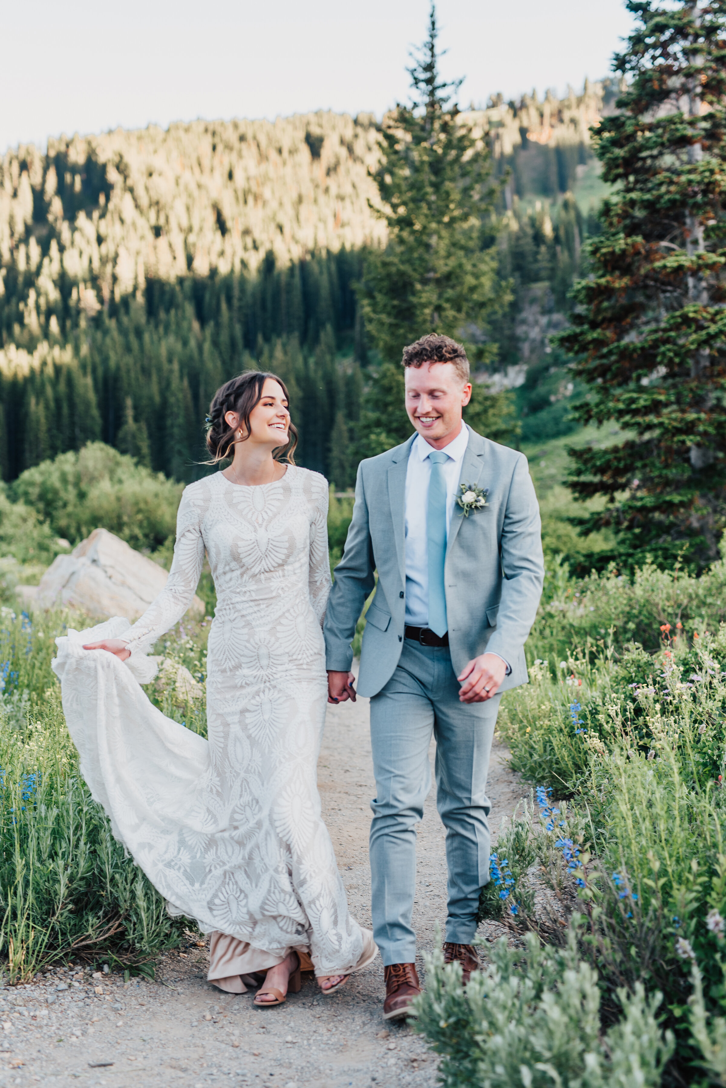 Happy bride and groom walking into forever up Logan canyon at Tony Grove. Kristi Alyse photography Logan Utah wedding photographer forest nature dreamy formals Logan canyon Tony Grove scenic bridals Northern Utah photographer Utah brides bride and groom Cache Valley #kristialysephotography #loganutahphotographer #tonygrove #logancanyon #utahweddingphotographer #bridals #formals #wildflowers #northernutah #utahbrides