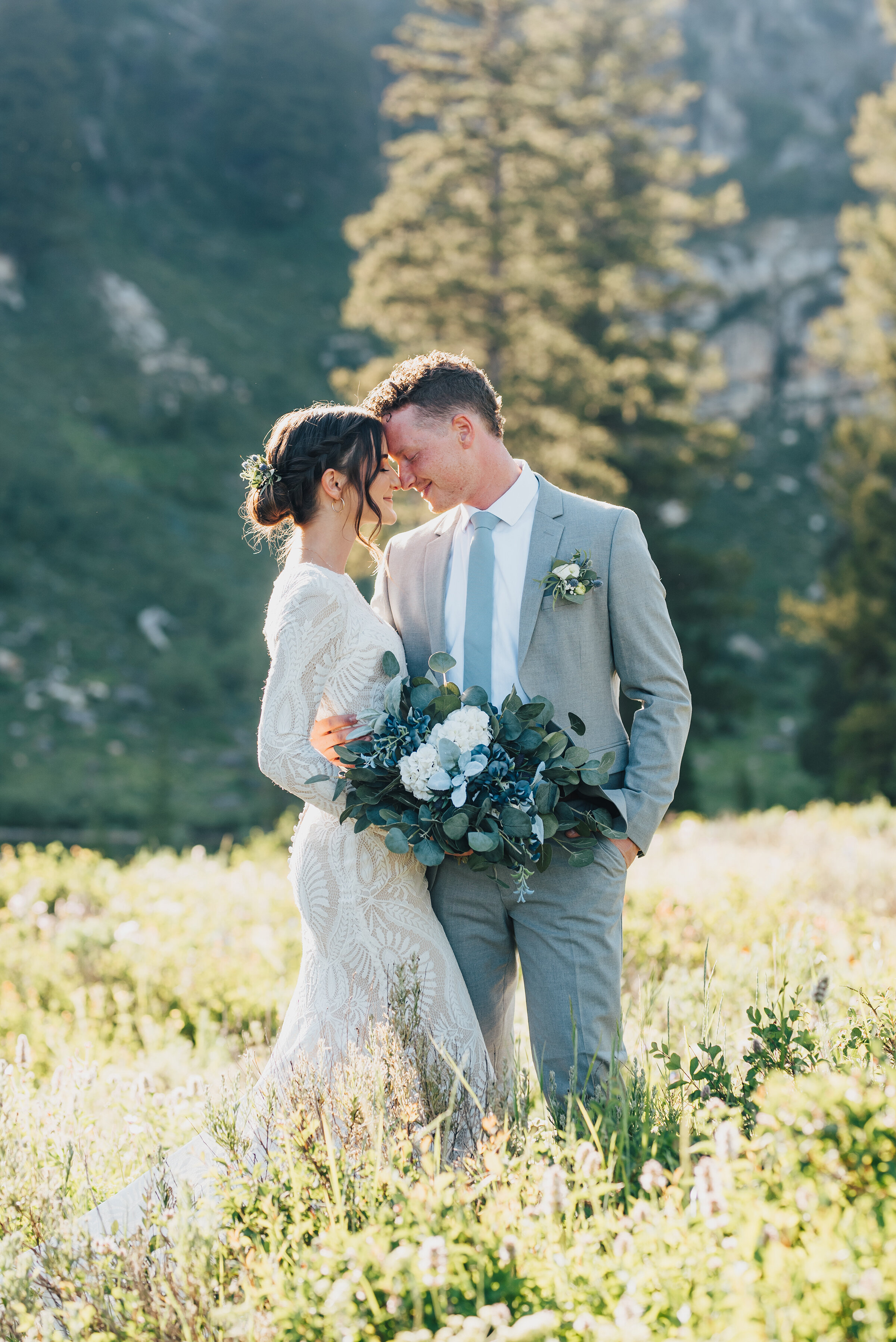 Tender embrace amongst wild flowers and pine trees up Logan canyon at Tony Grove. Kristi Alyse photography Logan Utah wedding photographer forest nature dreamy formals Logan canyon Tony Grove scenic bridals Northern Utah photographer Utah brides bride and groom Cache Valley #kristialysephotography #loganutahphotographer #tonygrove #logancanyon #utahweddingphotographer #bridals #formals #wildflowers #northernutah #utahbrides