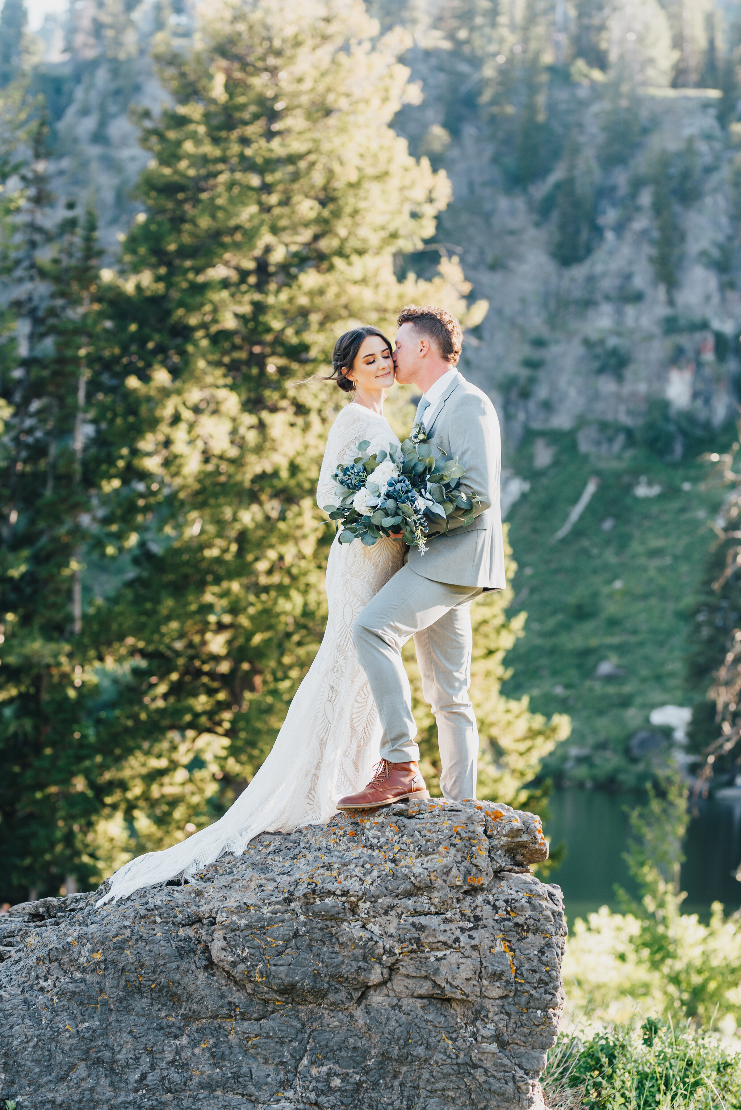 Stunning artsy capture of bride and groom during their formals up Logan canyon. Kristi Alyse photography Logan Utah wedding photographer forest nature dreamy formals Logan canyon Tony Grove scenic bridals Northern Utah photographer Utah brides bride and groom Cache Valley #kristialysephotography #loganutahphotographer #tonygrove #logancanyon #utahweddingphotographer #bridals #formals #wildflowers #northernutah #utahbrides