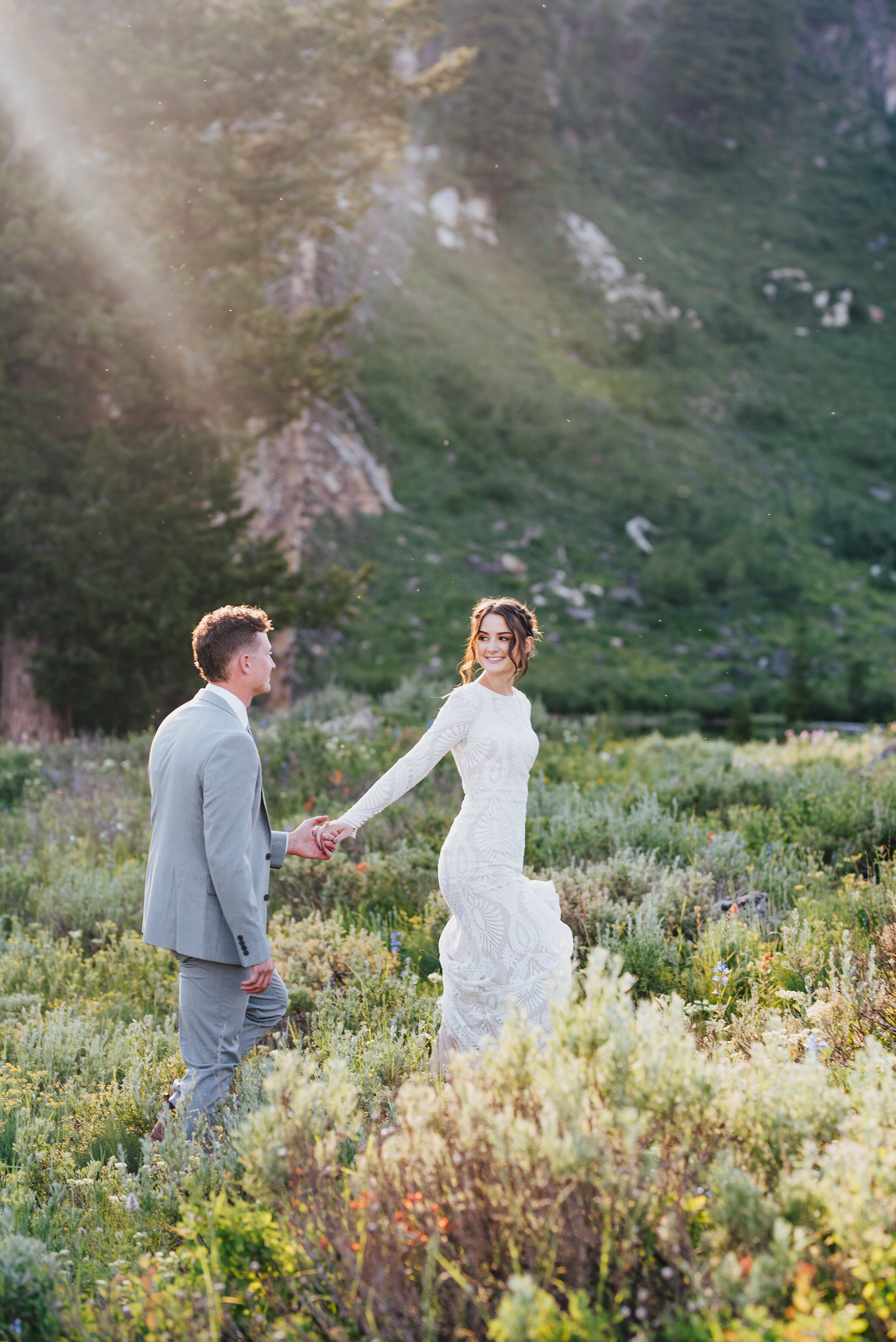 Leading with love in this dreamy picturesque setting up Logan canyon. Kristi Alyse photography Logan Utah wedding photographer forest nature dreamy formals Logan canyon Tony Grove scenic bridals Northern Utah photographer Utah brides bride and groom Cache Valley #kristialysephotography #loganutahphotographer #tonygrove #logancanyon #utahweddingphotographer #bridals #formals #wildflowers #northernutah #utahbrides