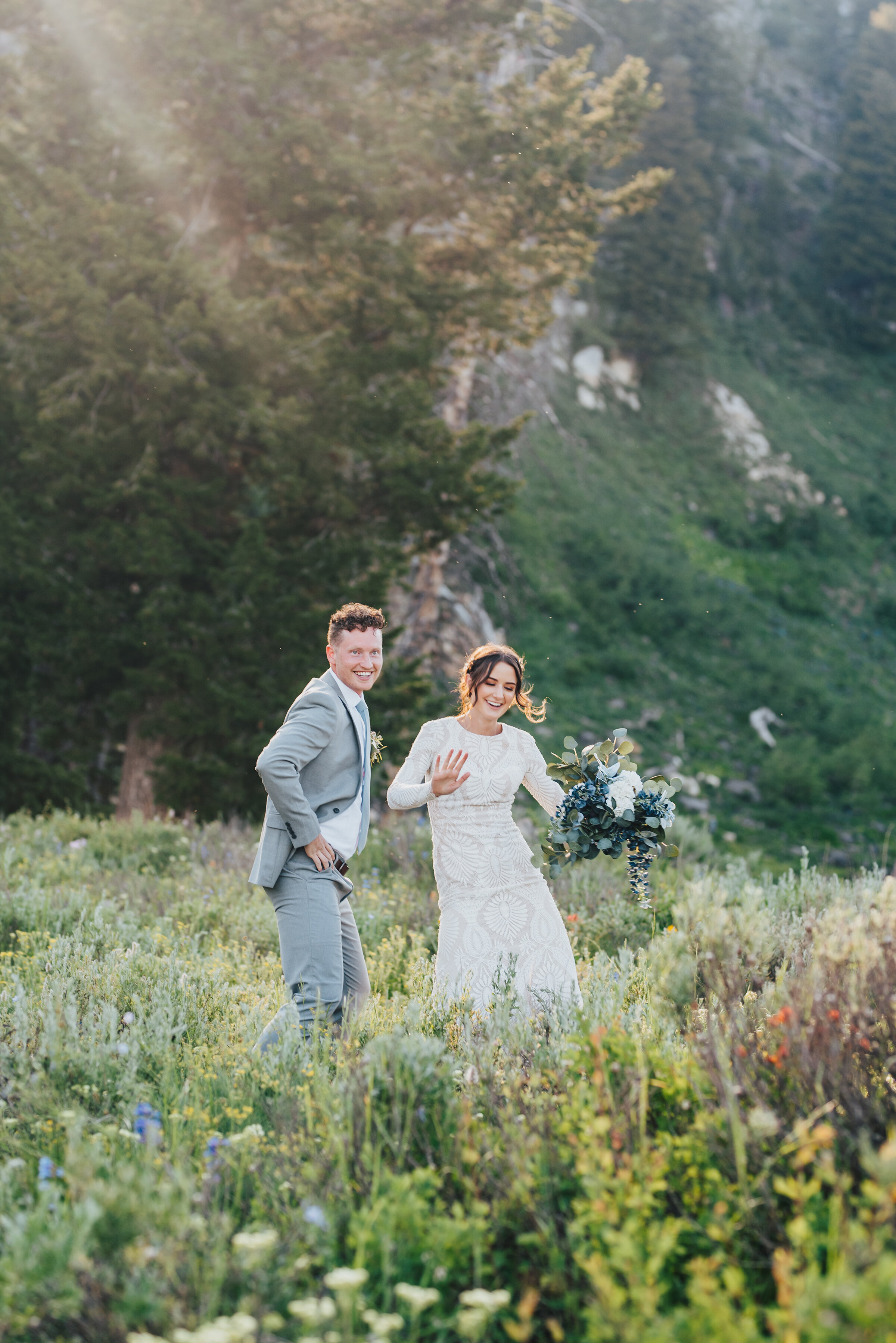 Playful bride and groom in this dreamy wild flower filled meadow for their formals up Logan canyon. Kristi Alyse photography Logan Utah wedding photographer forest nature dreamy formals Logan canyon Tony Grove scenic bridals Northern Utah photographer Utah brides bride and groom Cache Valley #kristialysephotography #loganutahphotographer #tonygrove #logancanyon #utahweddingphotographer #bridals #formals #wildflowers #northernutah #utahbrides