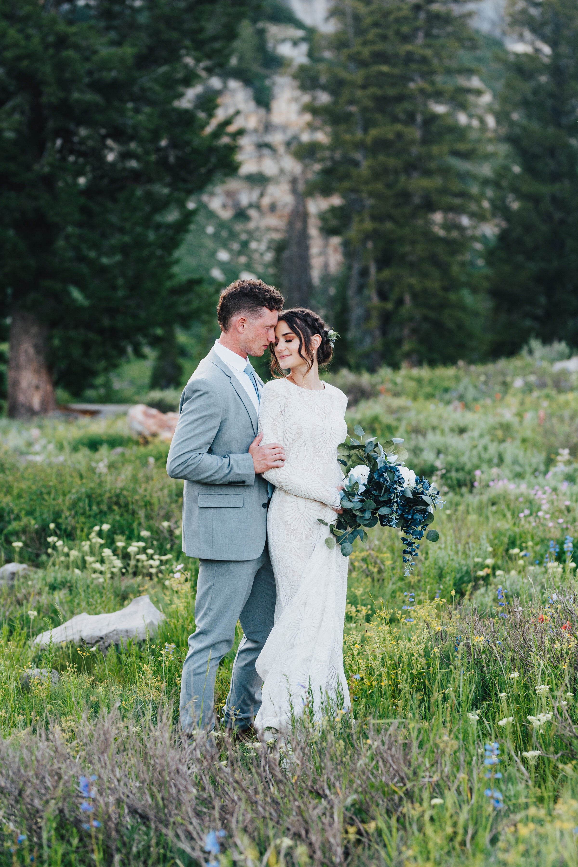 Bride and groom so in love during their formals up Logan canyon at Tony Grove. Kristi Alyse photography Logan Utah wedding photographer forest nature dreamy formals Logan canyon Tony Grove scenic bridals Northern Utah photographer Utah brides bride and groom Cache Valley #kristialysephotography #loganutahphotographer #tonygrove #logancanyon #utahweddingphotographer #bridals #formals #wildflowers #northernutah #utahbrides