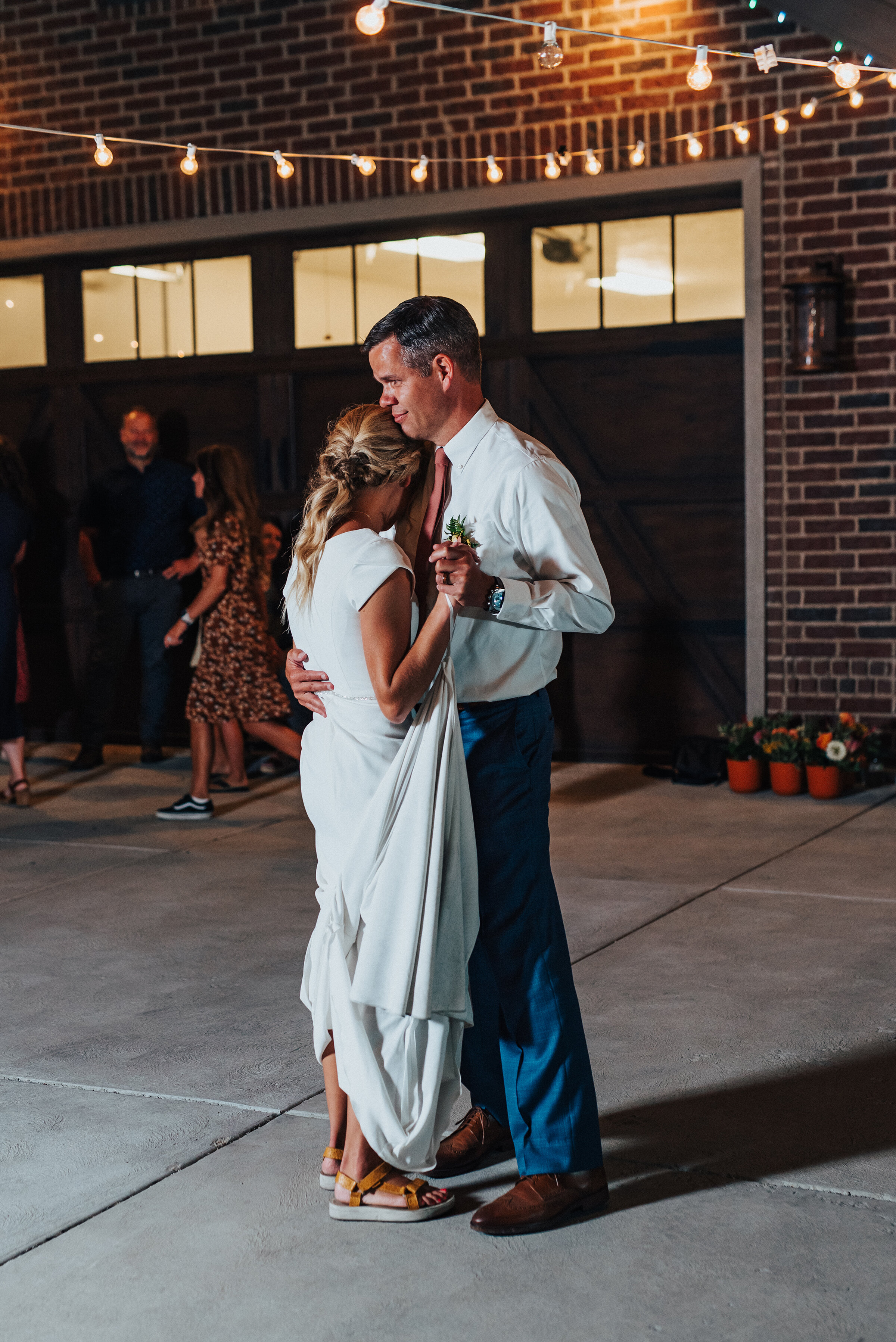 Father of the bride dancing with his daughter at her backyard wedding reception in Park City. Kristi Alyse Photography Logan Utah photographer Park City wedding photographer Drive-Thru wedding COVID wedding neon signs socially distant wedding bride and groom father of the bride dance #kristialysephotography #weddingphotographer #utahweddings #parkcity #utahbrides #drivethruwedding #covidwedding #LoganUtahphotographer #utahweddingphotographer #fatherofthebride