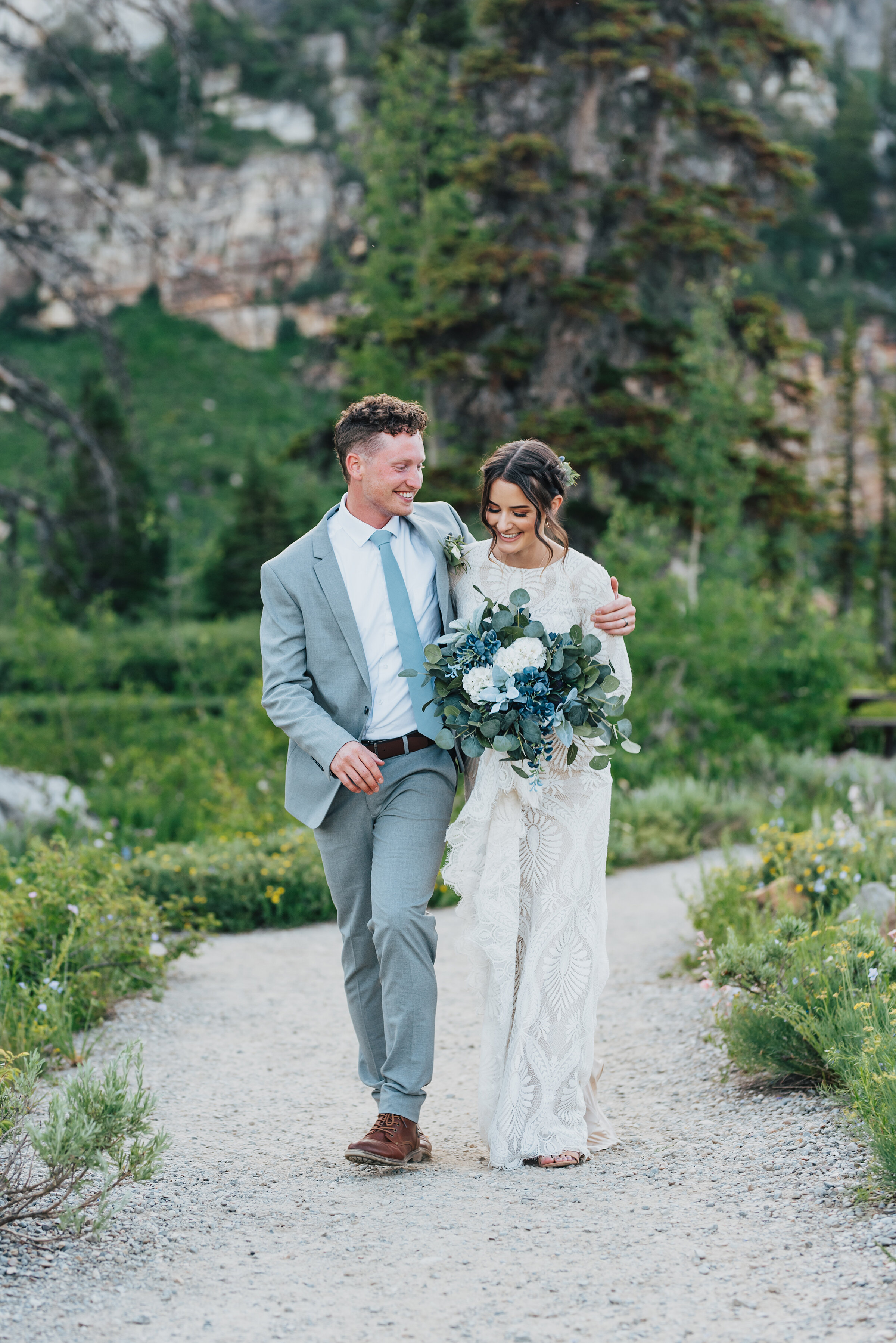 Bride and Groom bursting with love during their formals up Logan canyon. Kristi Alyse photography Logan Utah wedding photographer forest nature dreamy formals Logan canyon Tony Grove scenic bridals Northern Utah photographer Utah brides bride and groom Cache Valley #kristialysephotography #loganutahphotographer #tonygrove #logancanyon #utahweddingphotographer #bridals #formals #wildflowers #northernutah #utahbrides