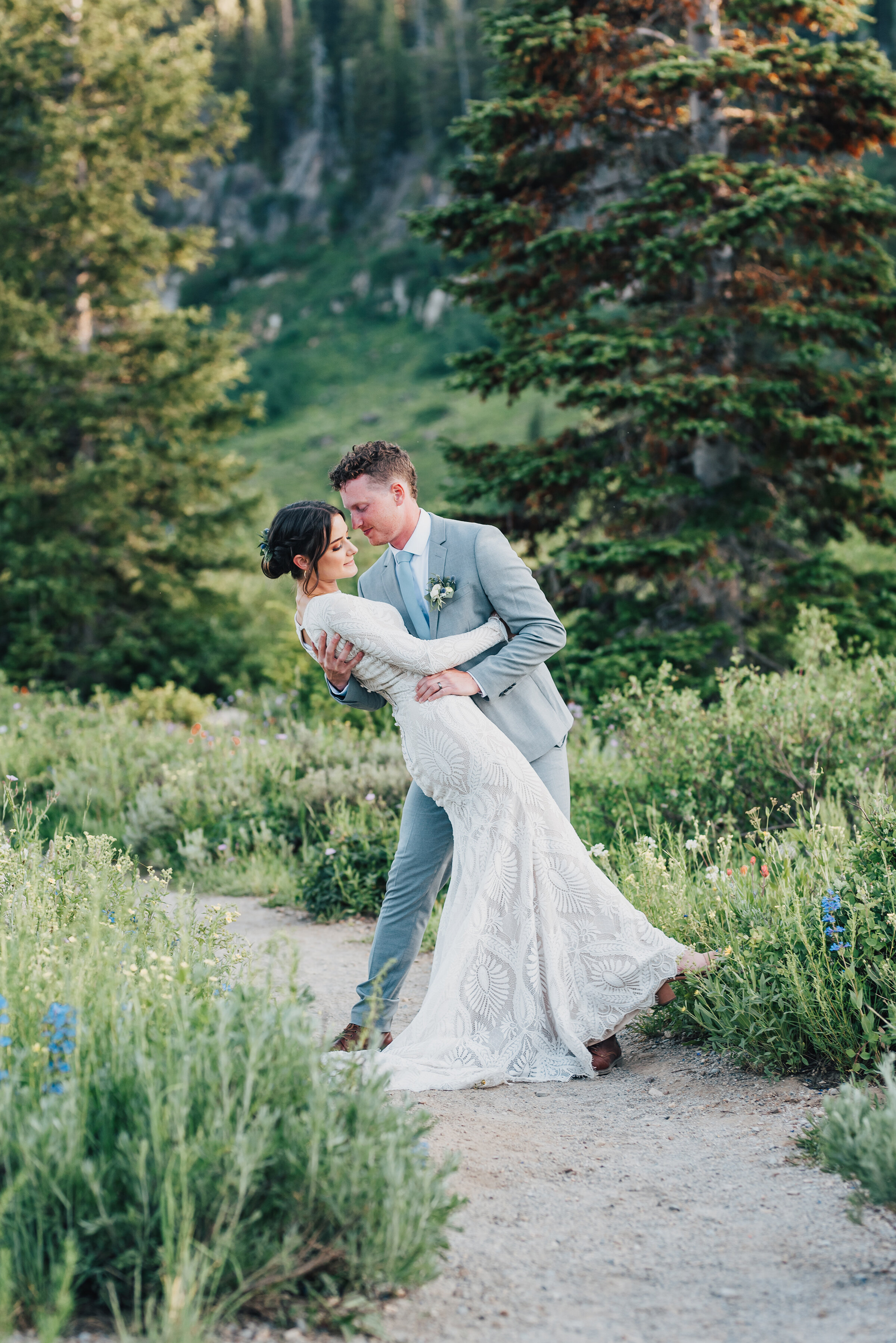 Dreamy formals surrounded by pine trees and wild flowers up Logan canyon. Kristi Alyse photography Logan Utah wedding photographer forest nature dreamy formals Logan canyon Tony Grove scenic bridals Northern Utah photographer Utah brides bride and groom Cache Valley #kristialysephotography #loganutahphotographer #tonygrove #logancanyon #utahweddingphotographer #bridals #formals #wildflowers #northernutah #utahbrides
