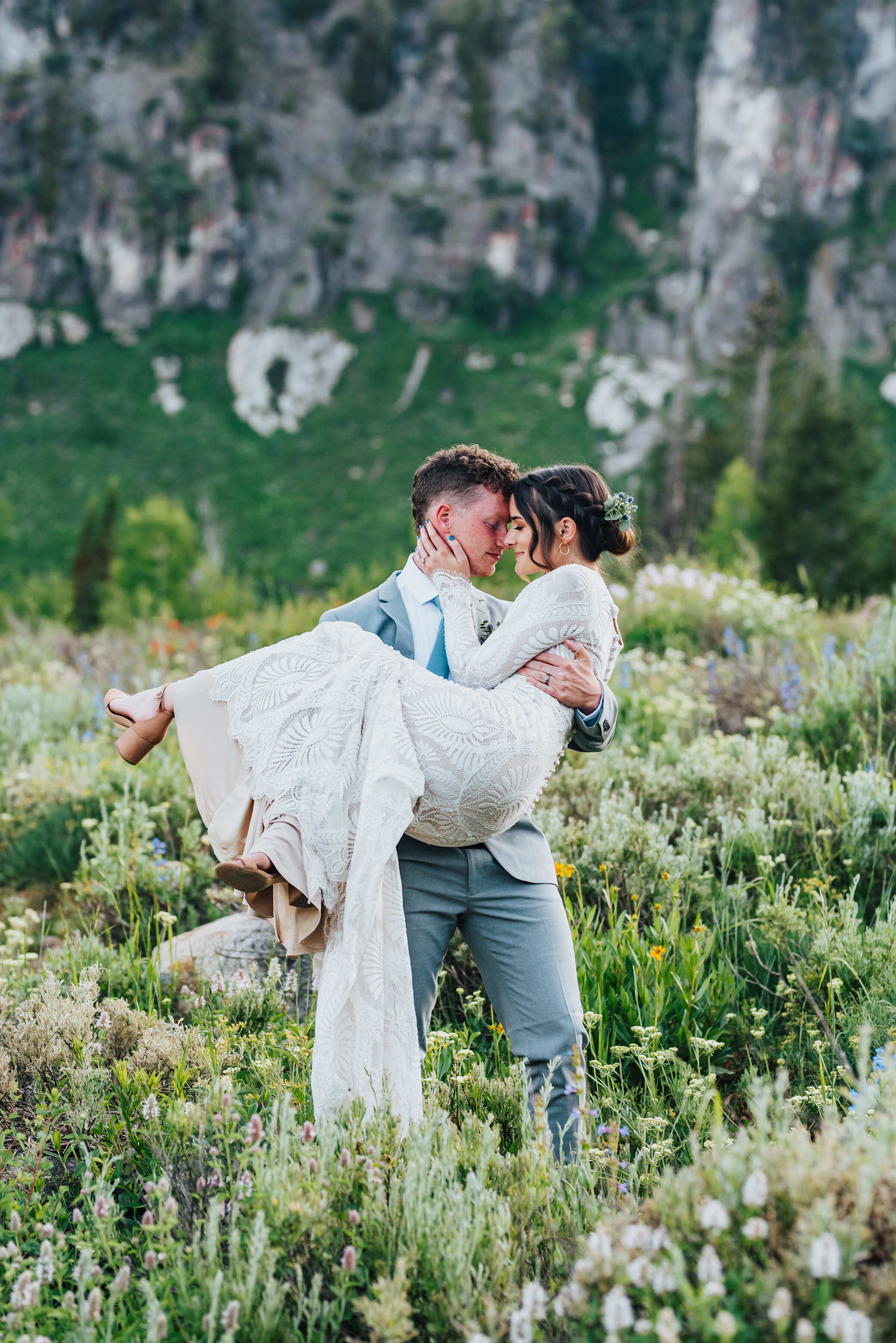 Stunning couple surrounded by wild flowers during their formals up Logan canyon. Kristi Alyse photography Logan Utah wedding photographer forest nature dreamy formals Logan canyon Tony Grove scenic bridals Northern Utah photographer Utah brides bride and groom Cache Valley #kristialysephotography #loganutahphotographer #tonygrove #logancanyon #utahweddingphotographer #bridals #formals #wildflowers #northernutah #utahbrides