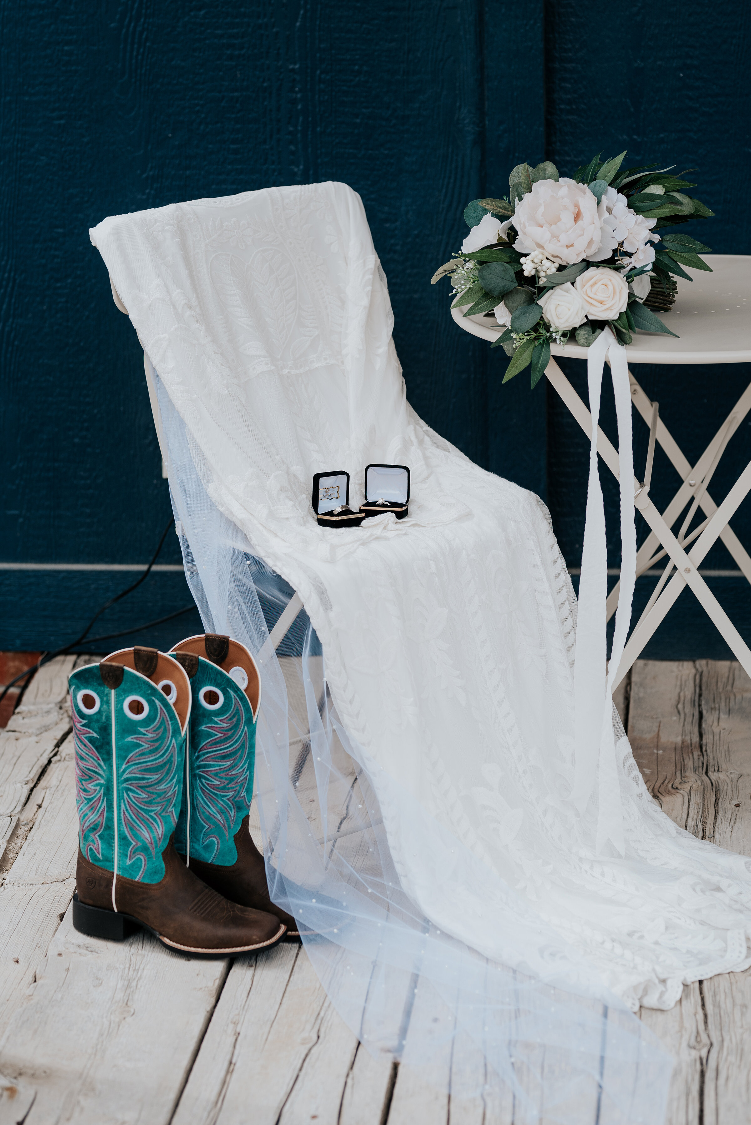 Stunning turquoise blue cowgirl boots with flares of pink accented the gorgeous tule wedding gown the bride wore on her wedding day. Wedding day photoshoot in Ephraim Utah photography wedding outdoor location western inspired rustic Airbnb photo aesthetic #ephraimutah #utahphotography #weddingdayphotography #gettingmarried #rusticwedding #utahwedding #westernstyle #weddingphotoshoot