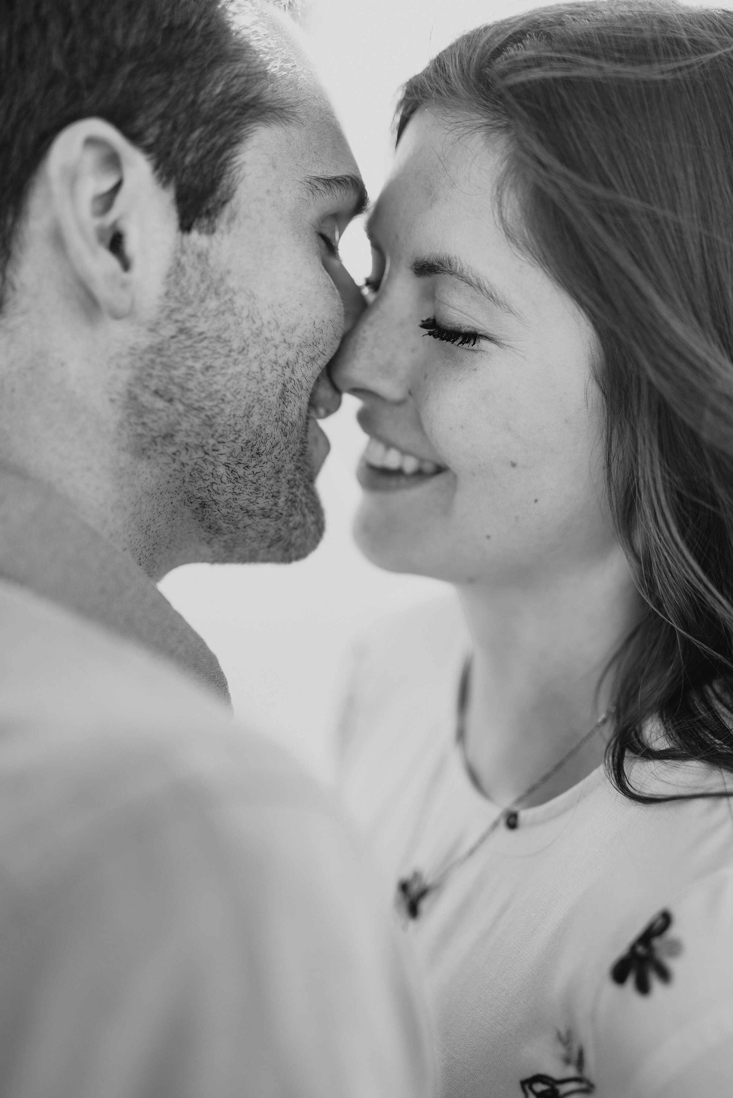 Couple almost kissing in a black and white photo from their engagement session in Magna Utah on the Salt Flats. Black and white photography inspiration utah engagement photoshoot in Magna Utah local photography session locations salt flat photography Kristi Alyse Photography black and white photo inspo utah wedding photographer #makememories #capture #foreverfamilies #engagements #utahphotographer #bestutahweddingphotographer #kissinginatree #magnautah