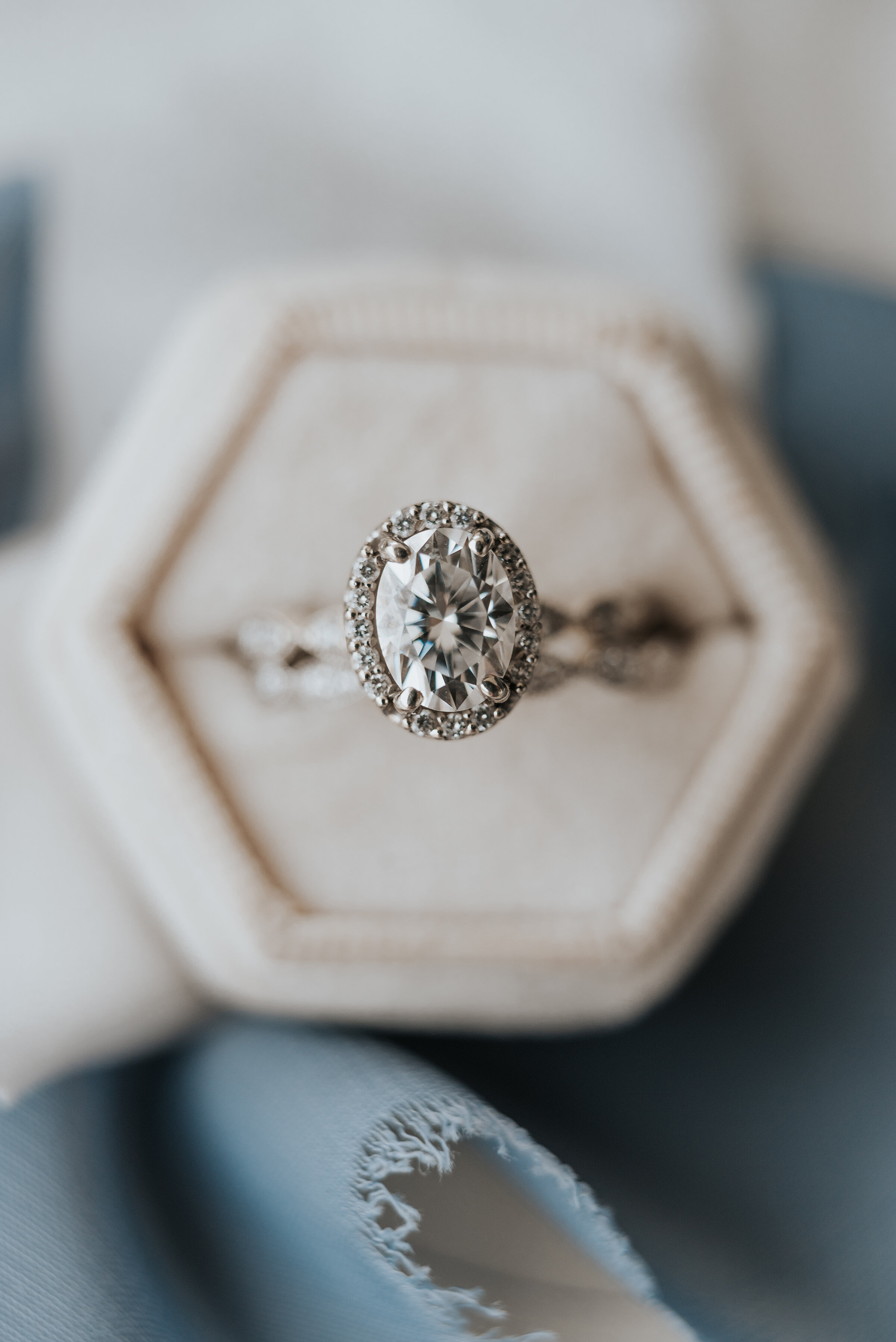 Brides wedding ring set in a diamond halo and placed in the most gorgeous white ring box that allows each diamond to shine. Wedding ring photoshoot in Ephraim Utah photography wedding outdoor location western inspired rustic Airbnb photo aesthetic #ephraimutah #utahphotography #weddingdayphotography #gettingmarried #rusticwedding #utahwedding #westernstyle #weddingphotoshoot