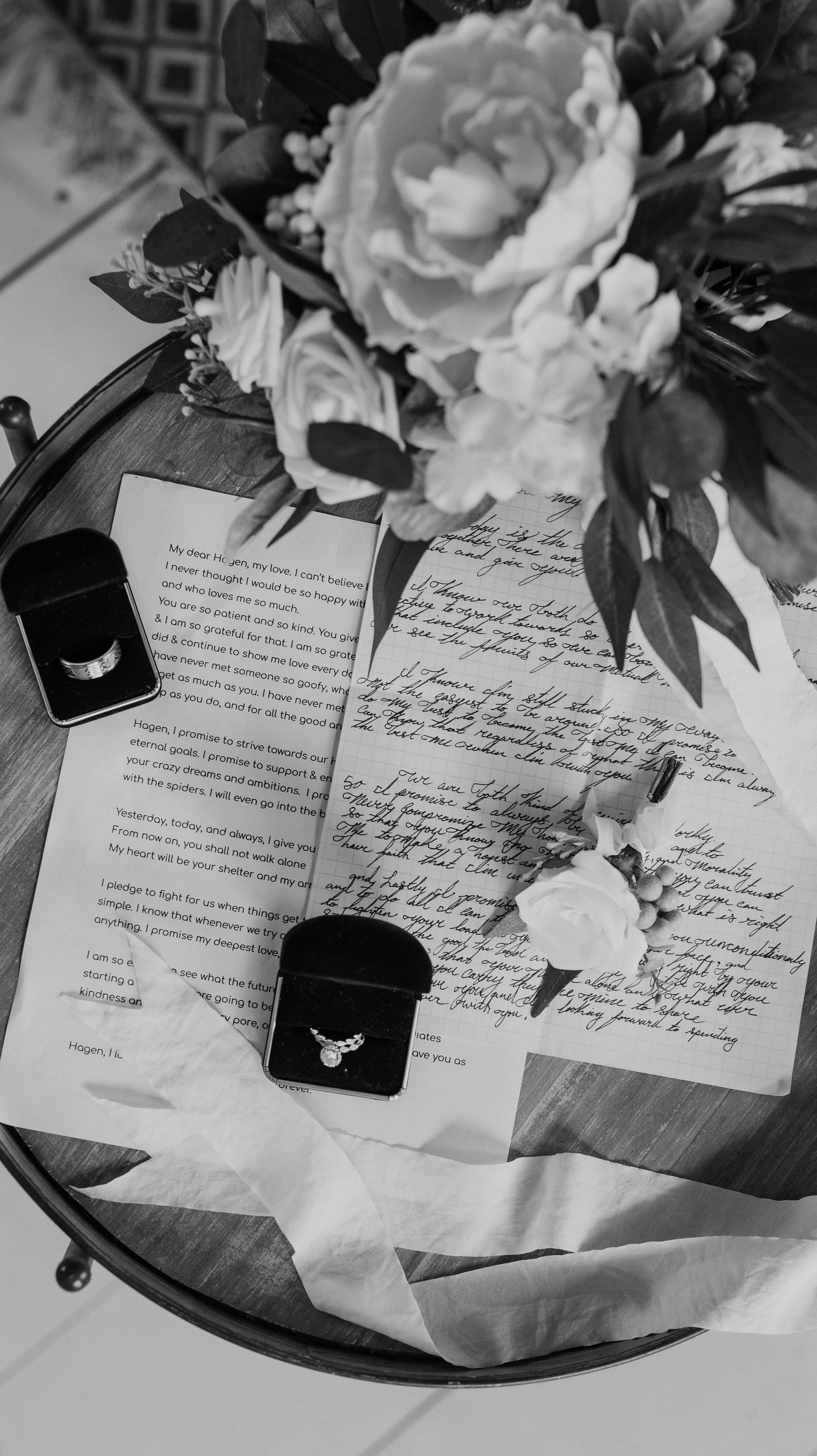 Wedding day details photographed by Kristy Alyse Photography including the wedding program, the bride's wedding ring and the flowers from her bouquet. photoshoot in Ephraim Utah photography wedding outdoor location western inspired rustic Airbnb photo aesthetic #ephraimutah #utahphotography #weddingdayphotography #gettingmarried #rusticwedding #utahwedding #westernstyle #weddingphotoshoot
