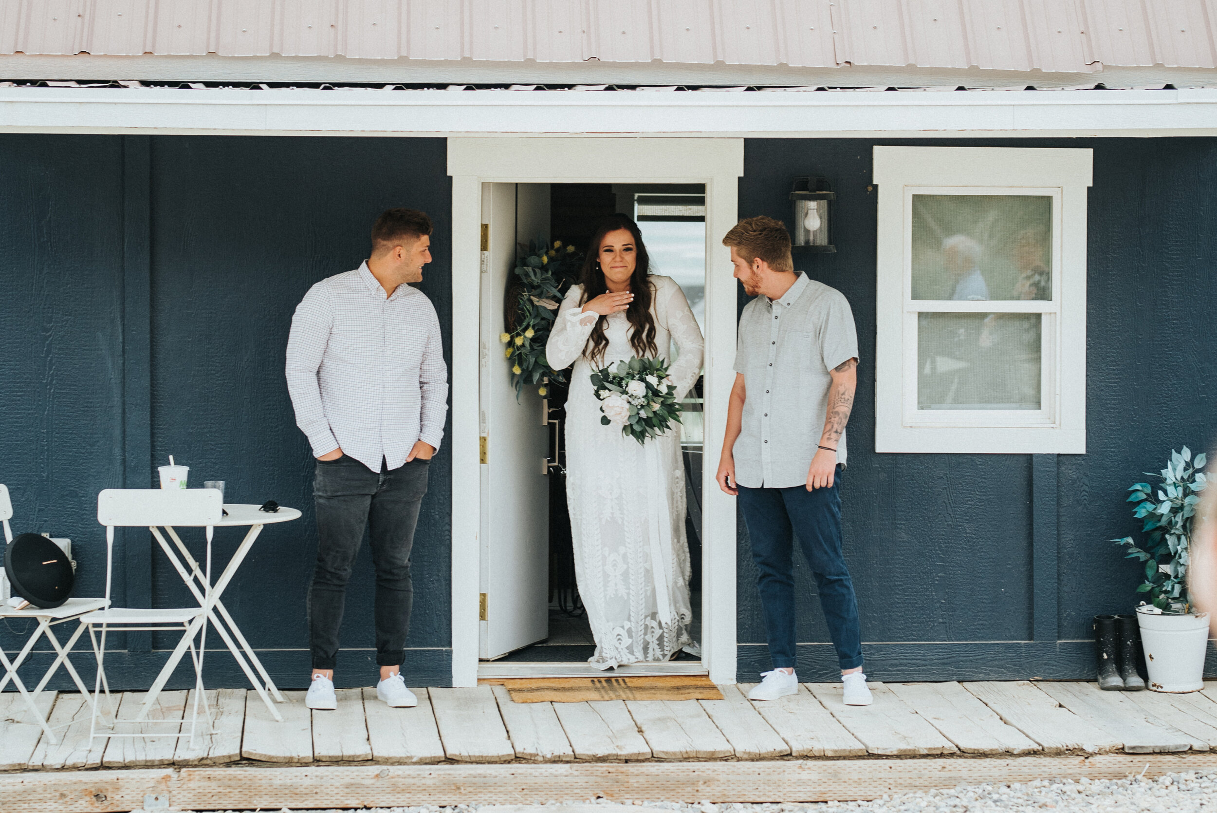 Wedding day photoshoot in Ephraim Utah photographed by Kristi Alyse Photography at the Airbnb rented for this special occasion. The first look of the bride as she prepared to walk down the ailse. photography wedding outdoor location western inspired rustic Airbnb photo aesthetic #ephraimutah #utahphotography #weddingdayphotography #gettingmarried #rusticwedding #utahwedding #westernstyle #weddingphotoshoot