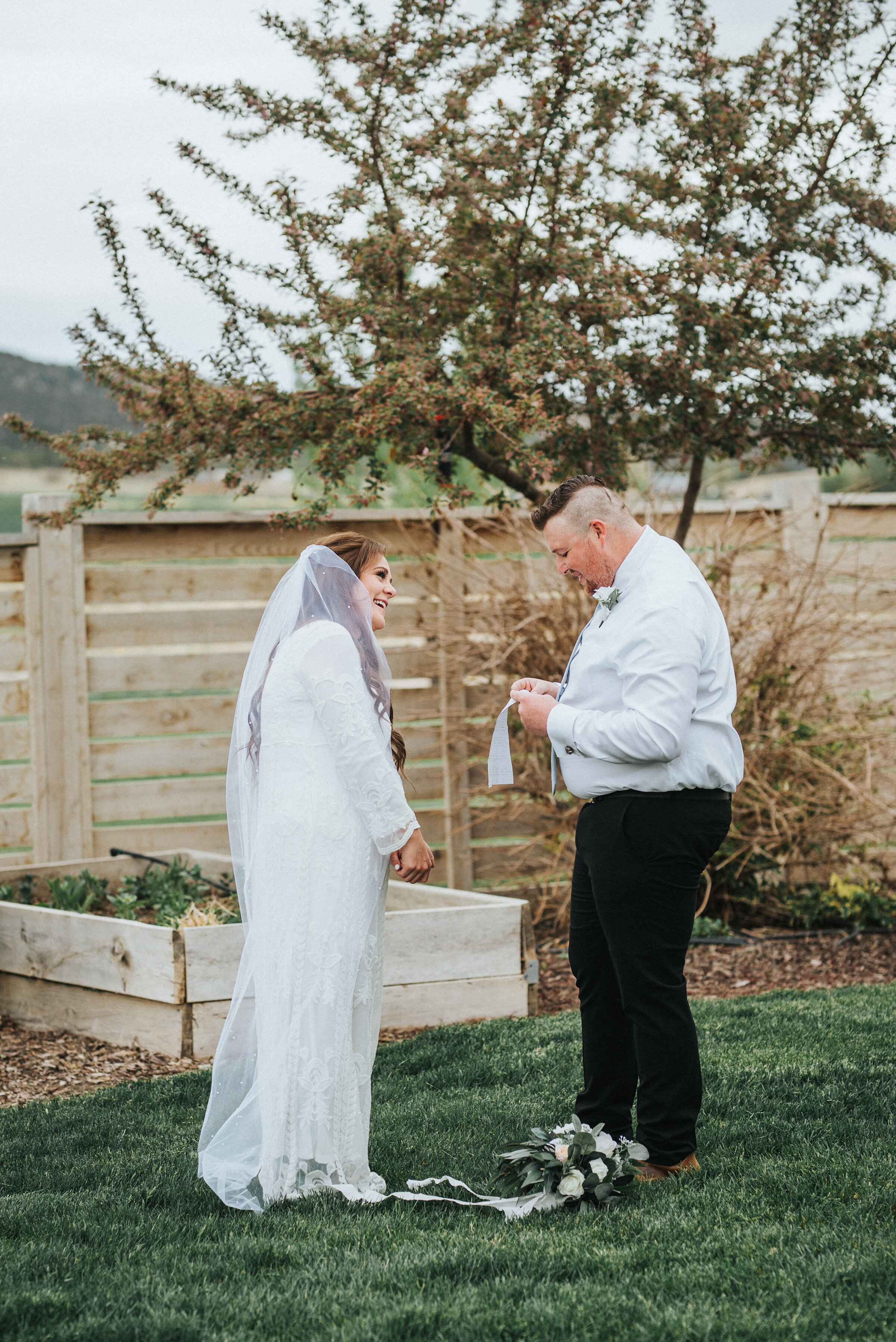 Emotional and tender vow exchange between the bride and groom outside of their Airbnb during their wedding ceremony in Ephraim, Utah. Wedding day photoshoot in Ephraim Utah photography wedding outdoor location western inspired rustic Airbnb photo aesthetic #ephraimutah #utahphotography #weddingdayphotography #gettingmarried #rusticwedding #utahwedding #westernstyle #weddingphotoshoot