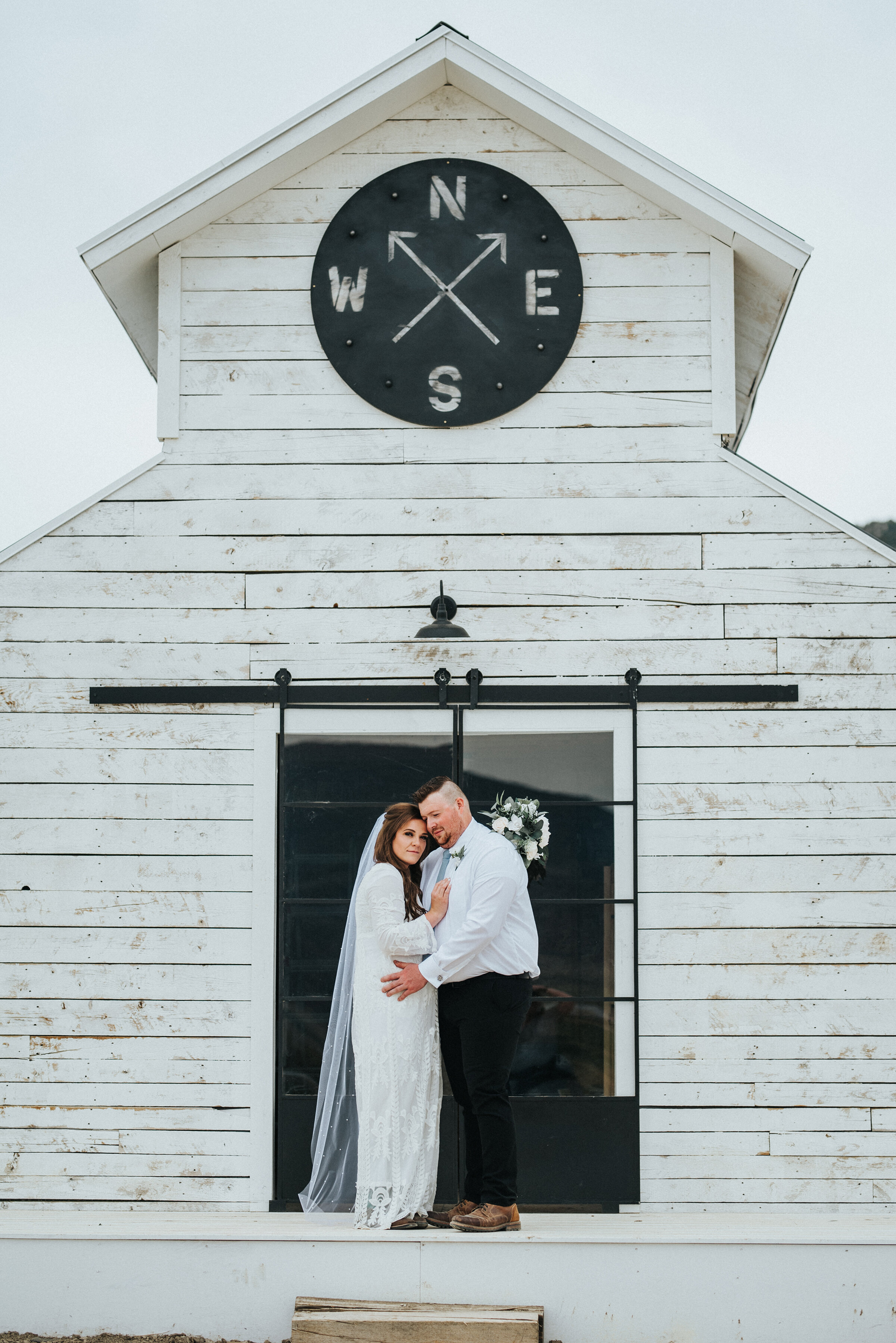 The perfect accent building on this Airbnb property for the bride and groom to stand in front of. White barn rustic western authentic intimate photoshoot in Ephraim Utah photography wedding outdoor location western inspired rustic Airbnb photo aesthetic #ephraimutah #utahphotography #weddingdayphotography #gettingmarried #rusticwedding #utahwedding #westernstyle #weddingphotoshoot