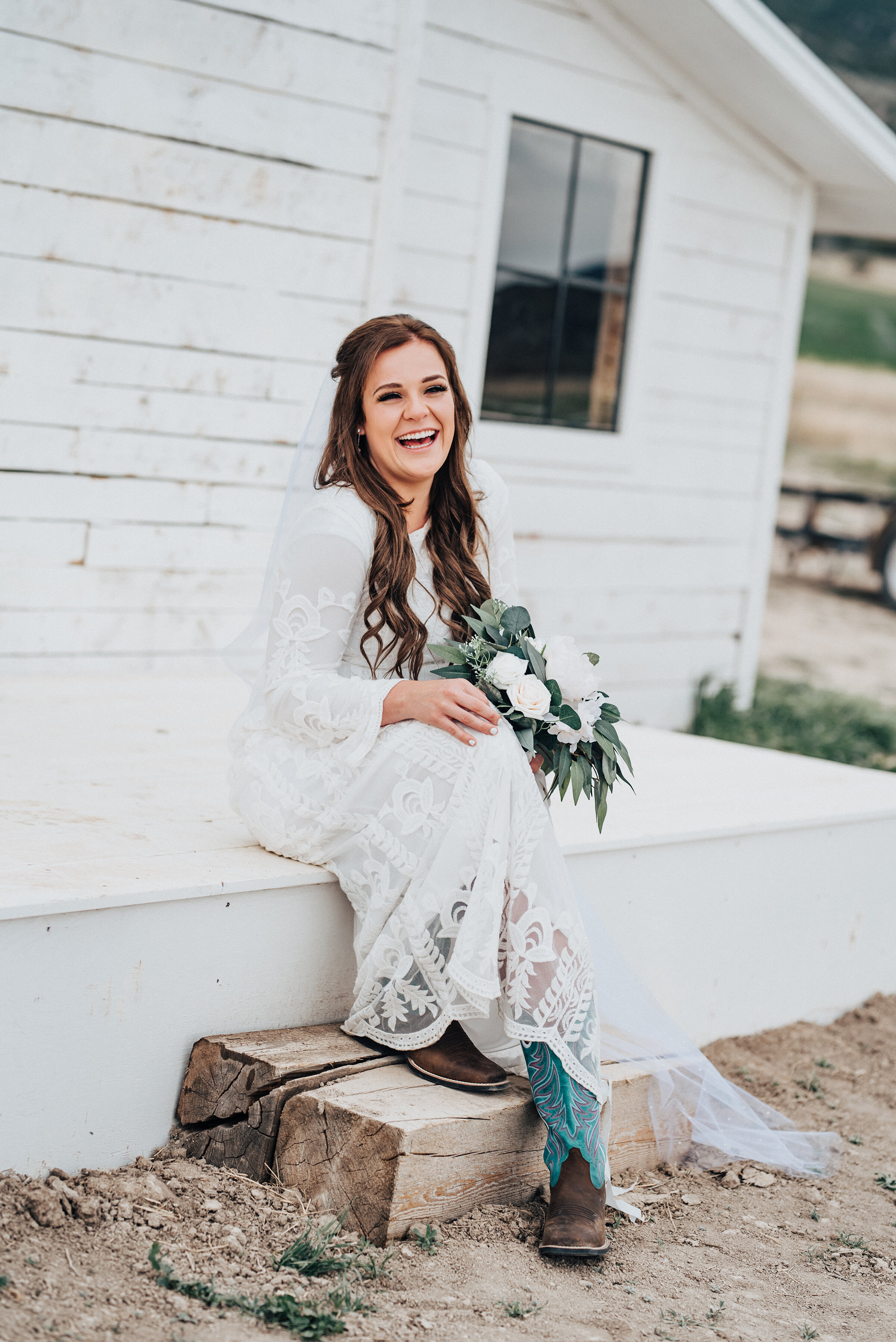 The details in this brides wedding gown all the way down to her festive western cowgirl boots were special and unique for this bride. Wedding day photoshoot in Ephraim Utah photography wedding outdoor location western inspired rustic Airbnb photo aesthetic #ephraimutah #utahphotography #weddingdayphotography #gettingmarried #rusticwedding #utahwedding #westernstyle #weddingphotoshoot