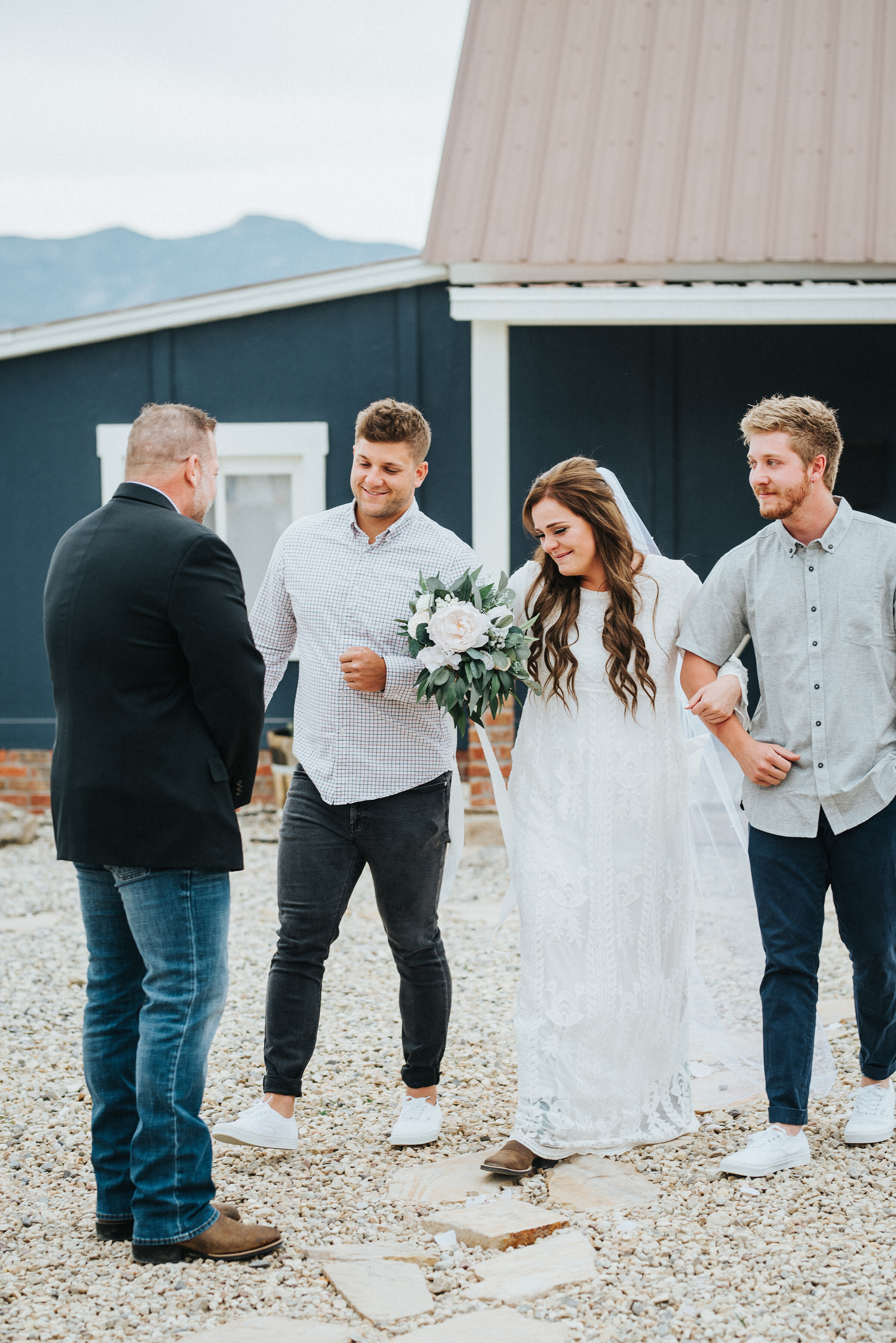 Walking down the aisle and being given away to the anxiously awaiting groom. The bride looked stunning and ready to marry the love of her life. photoshoot in Ephraim Utah photography wedding outdoor location western inspired rustic Airbnb photo aesthetic #ephraimutah #utahphotography #weddingdayphotography #gettingmarried #rusticwedding #utahwedding #westernstyle #weddingphotoshoot