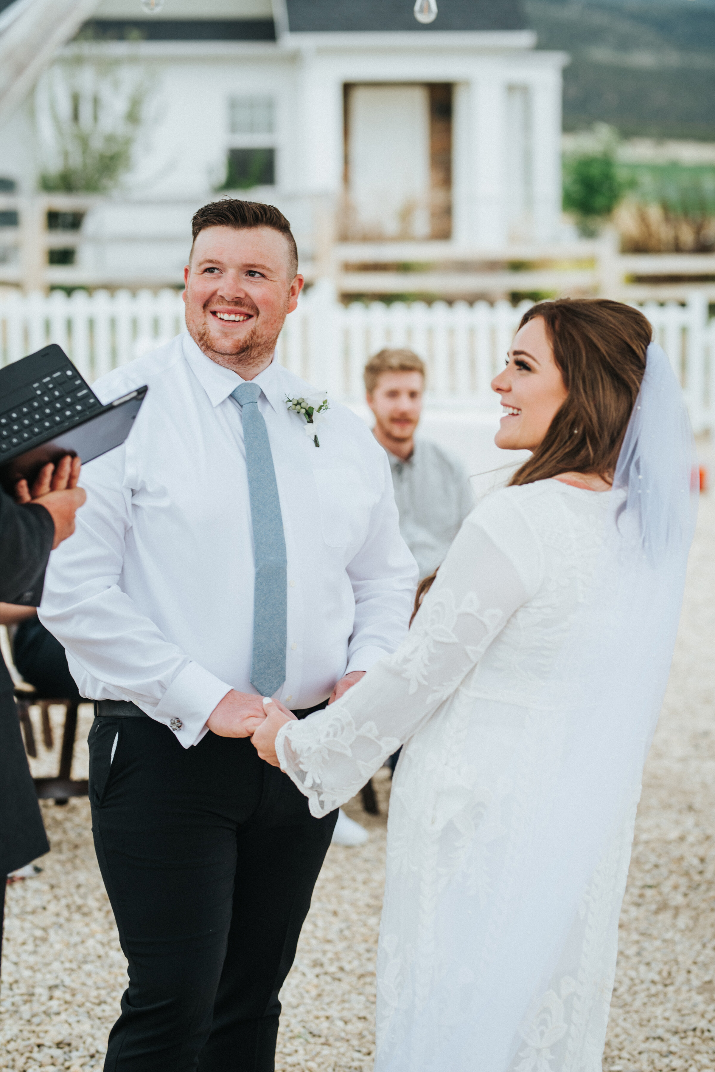 The bride and groom on their wedding day getting ready to exchange vows during their intimate outdoor wedding ceremony. photoshoot in Ephraim Utah photography wedding outdoor location western inspired rustic Airbnb photo aesthetic #ephraimutah #utahphotography #weddingdayphotography #gettingmarried #rusticwedding #utahwedding #westernstyle #weddingphotoshoot