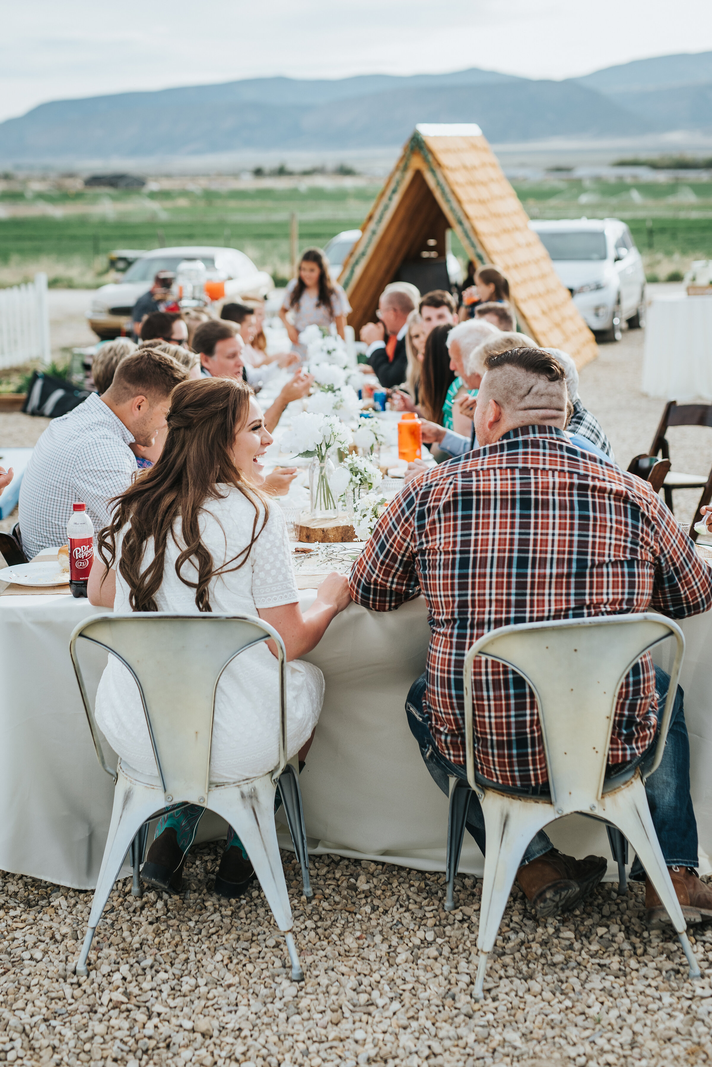 The party continued on their wedding day with an intimate luncheon and gathering to celebrate the newly joined bride and groom! photoshoot in Ephraim Utah photography wedding outdoor location western inspired rustic Airbnb photo aesthetic #ephraimutah #utahphotography #weddingdayphotography #gettingmarried #rusticwedding #utahwedding #westernstyle #weddingphotoshoot