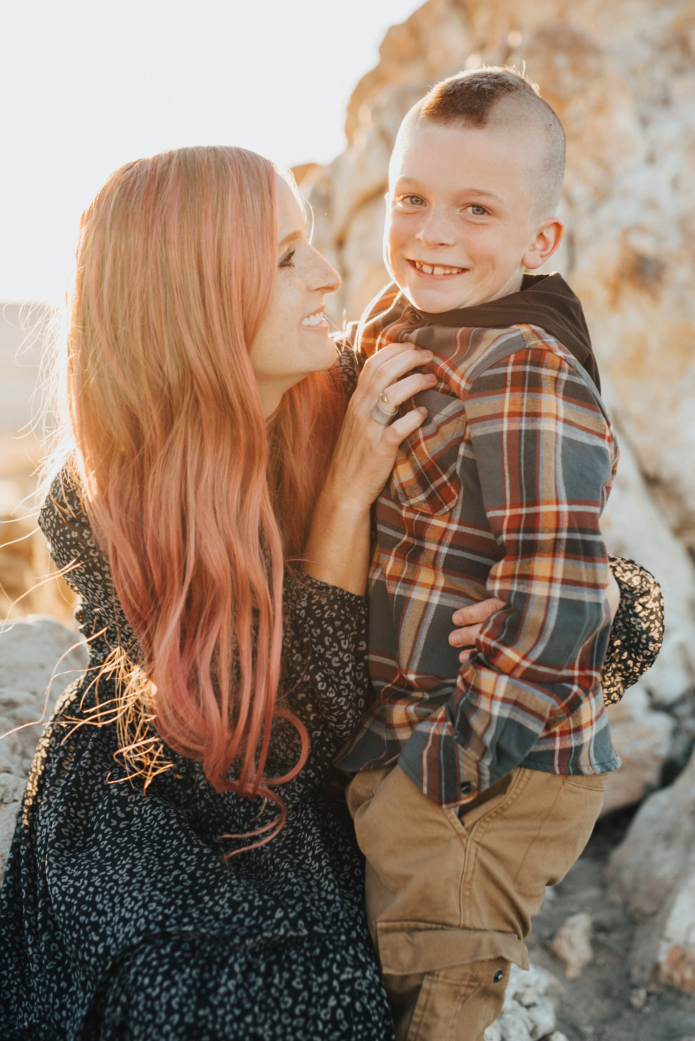 Adorable mother and son pose at Antelope Island by Salt Lake City family photographer Kristi Alyse Photography. Salt lake city family photographer family portraits outfit inspiration pink hair son mohawk plaid family outfits for family pics antelope island mother son family portraits pose professional family photographer #familypictures #utahphotographer #antelopeisland #outfitinspo #familypics #familyphotographer #pinkhair #saltlakecityphotog #slcfamilypictures