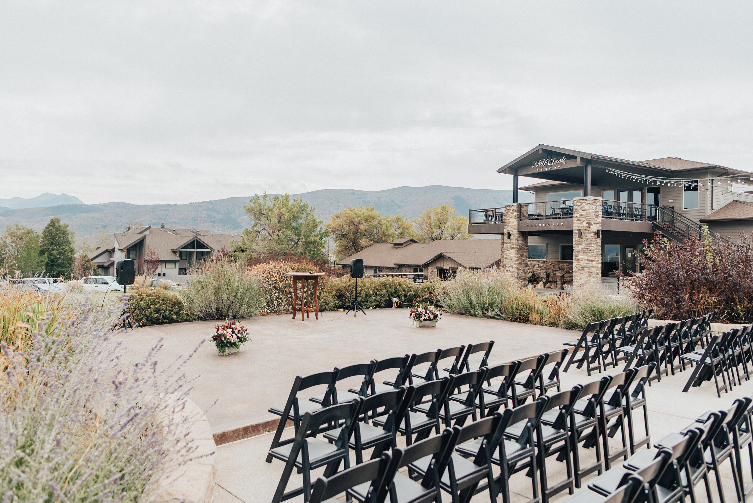 A stunning look of the wedding day ceremony in Logan, Utah by Kristi Alyse Photography. Ceremony background special moment the wedding day Kristi Alyse wedding ceremony inspo wedding details of the day black chairs floral details mountain backdrop wedding aisle #weddinginspo #loganutah #brideandgroom #utahbride #utahweddingphotographer #meaningfulmoment #weddingphotography #northernutahwedding #weddinghairstyles #weddingday #bridals